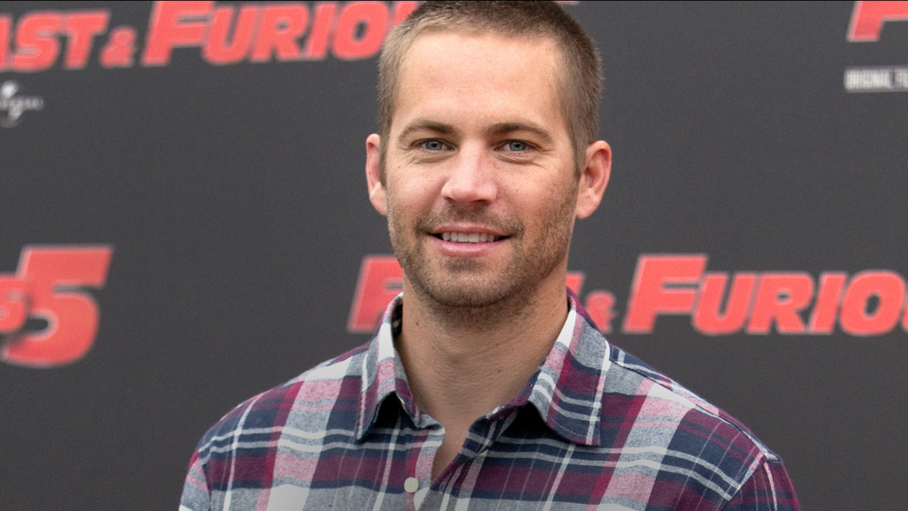 FILE - In this April 29, 2011 file photo, actor Paul Walker poses during the photo call of the movie 'Fast and Furious 5,' in Rome.