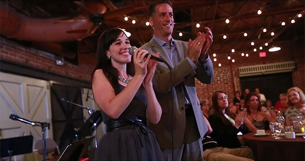 """<div class=""""meta image-caption""""><div class=""""origin-logo origin-image """"><span></span></div><span class=""""caption-text"""">At the Thank You Project event, Haddock--who is a singer--spoke and performed. (ArnoldPalmerHospital/YouTube)</span></div>"""