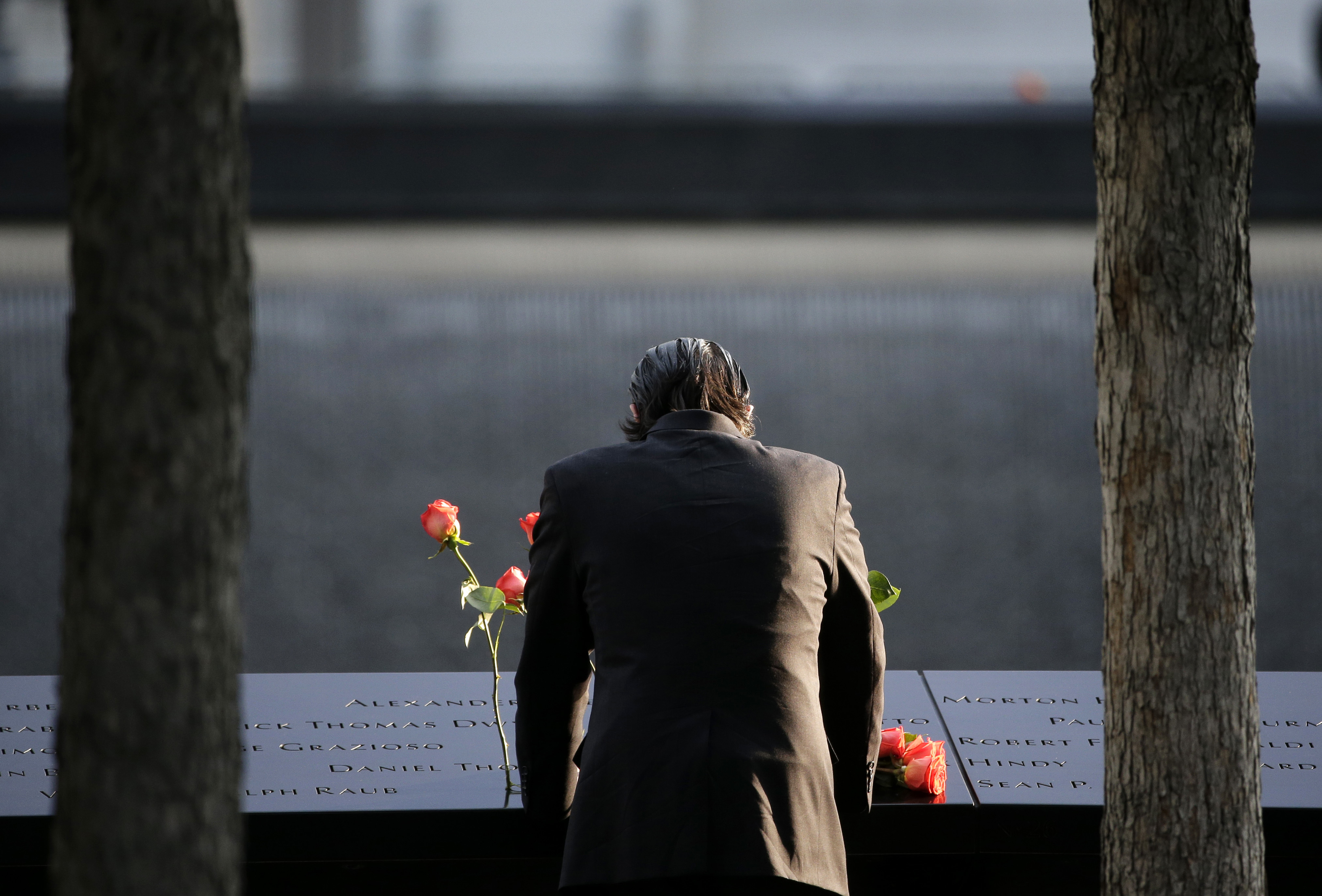 "<div class=""meta image-caption""><div class=""origin-logo origin-image none""><span>none</span></div><span class=""caption-text"">A man stands at the edge of a waterfall pool at ground zero during a ceremony on the 16th anniversary of the 9/11 attacks in New York.  Since September 11, 2001. (AP Photo/Seth Wenig)</span></div>"