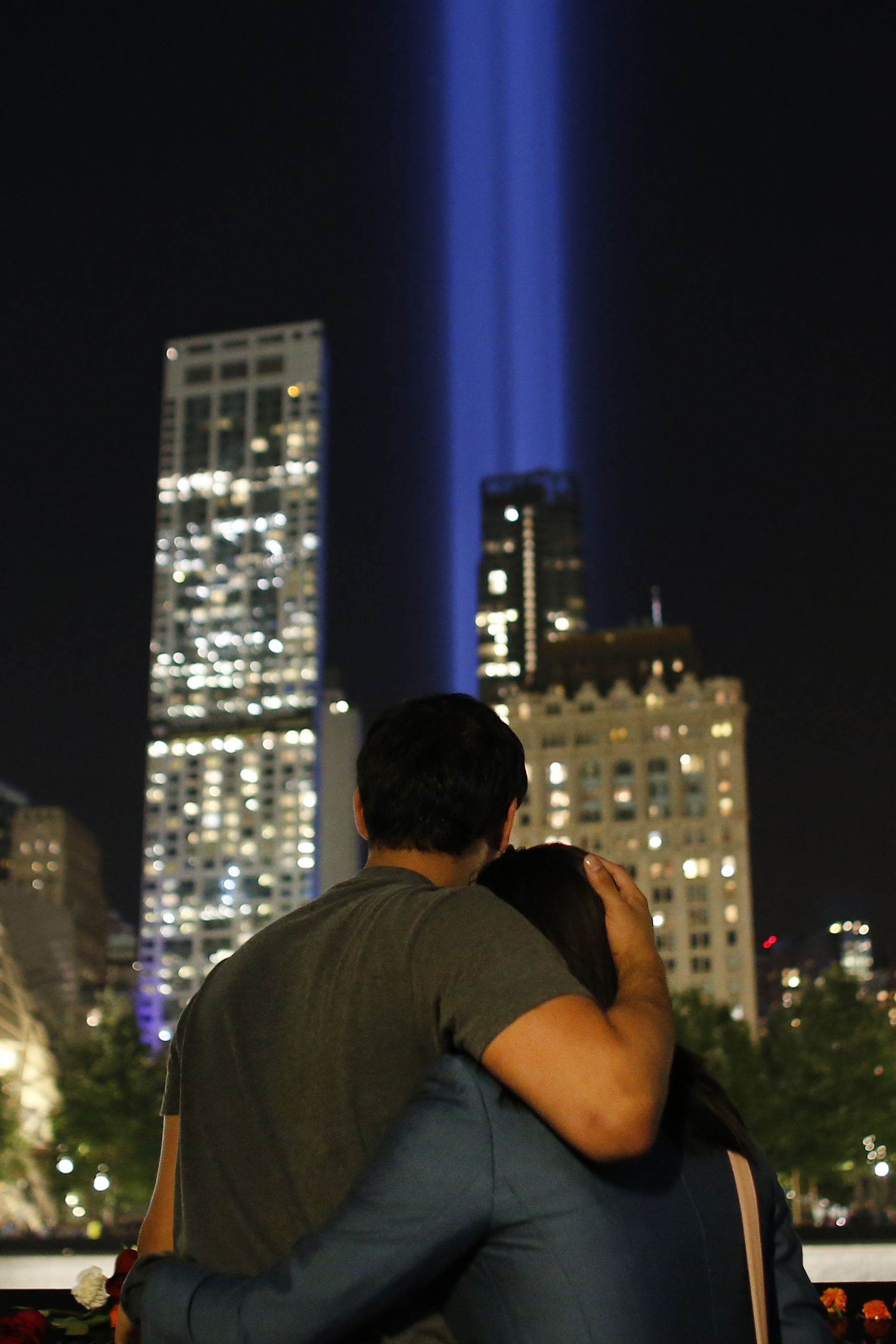 "<div class=""meta image-caption""><div class=""origin-logo origin-image none""><span>none</span></div><span class=""caption-text"">A couple embraces as the Tribute in Light is seen in the sky on the 16th anniversary of the Sept. 11 terror attacks, Monday, Sept. 11, 2017, in New York. (AP Photo/Jason DeCrow)</span></div>"