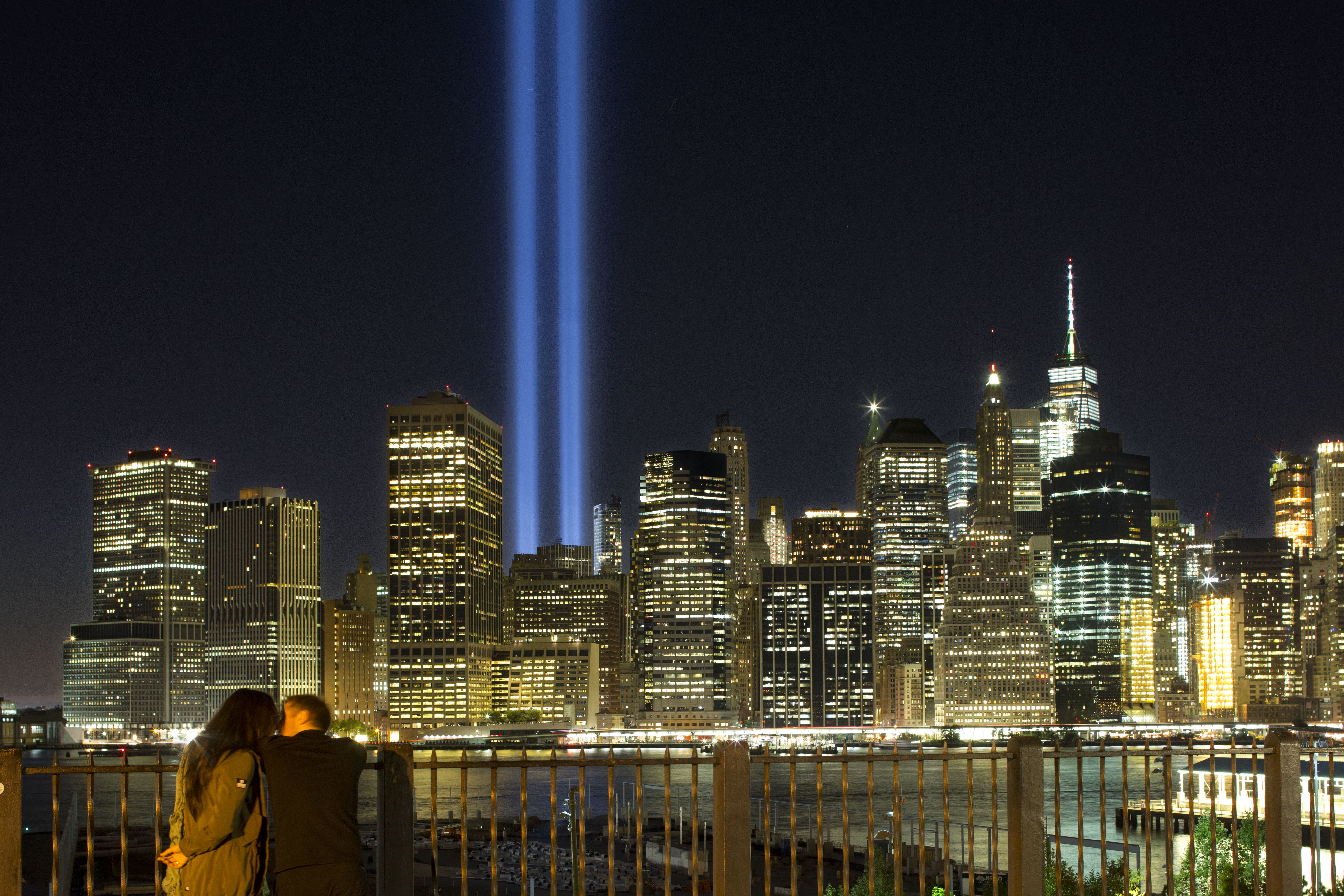 "<div class=""meta image-caption""><div class=""origin-logo origin-image none""><span>none</span></div><span class=""caption-text"">A couple embraces on the Brooklyn Promenade as the Tribute in Light rises above the lower Manhattan skyline Sunday, Sept. 10, 2017, in New York. (AP Photo/Mark Lennihan)</span></div>"