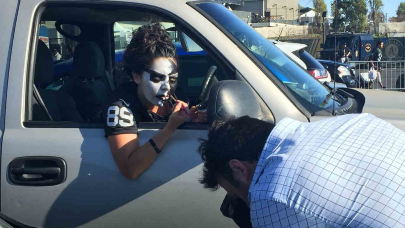 Raiders fans get ready for the season opener at the Oakland Coliseum in Oakland, Calif. on Monday, September 10, 2018.
