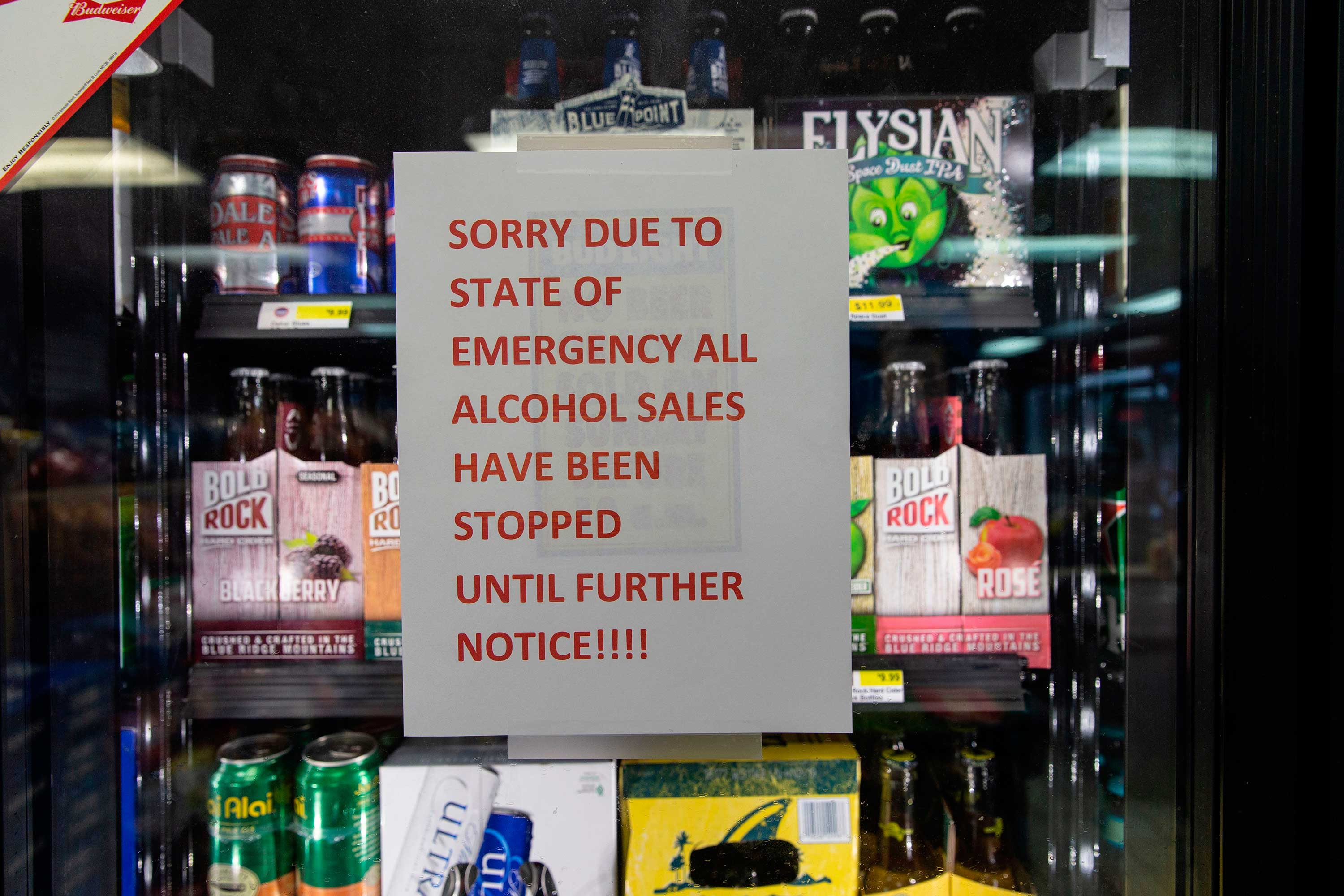 "<div class=""meta image-caption""><div class=""origin-logo origin-image none""><span>none</span></div><span class=""caption-text"">A sign warning customers that alcohol sales are suspended due to a 'state of emergency' at an Exxon station in Harbinger, North Carolina on September 11, 2018. (ALEX EDELMAN/AFP/Getty Images)</span></div>"