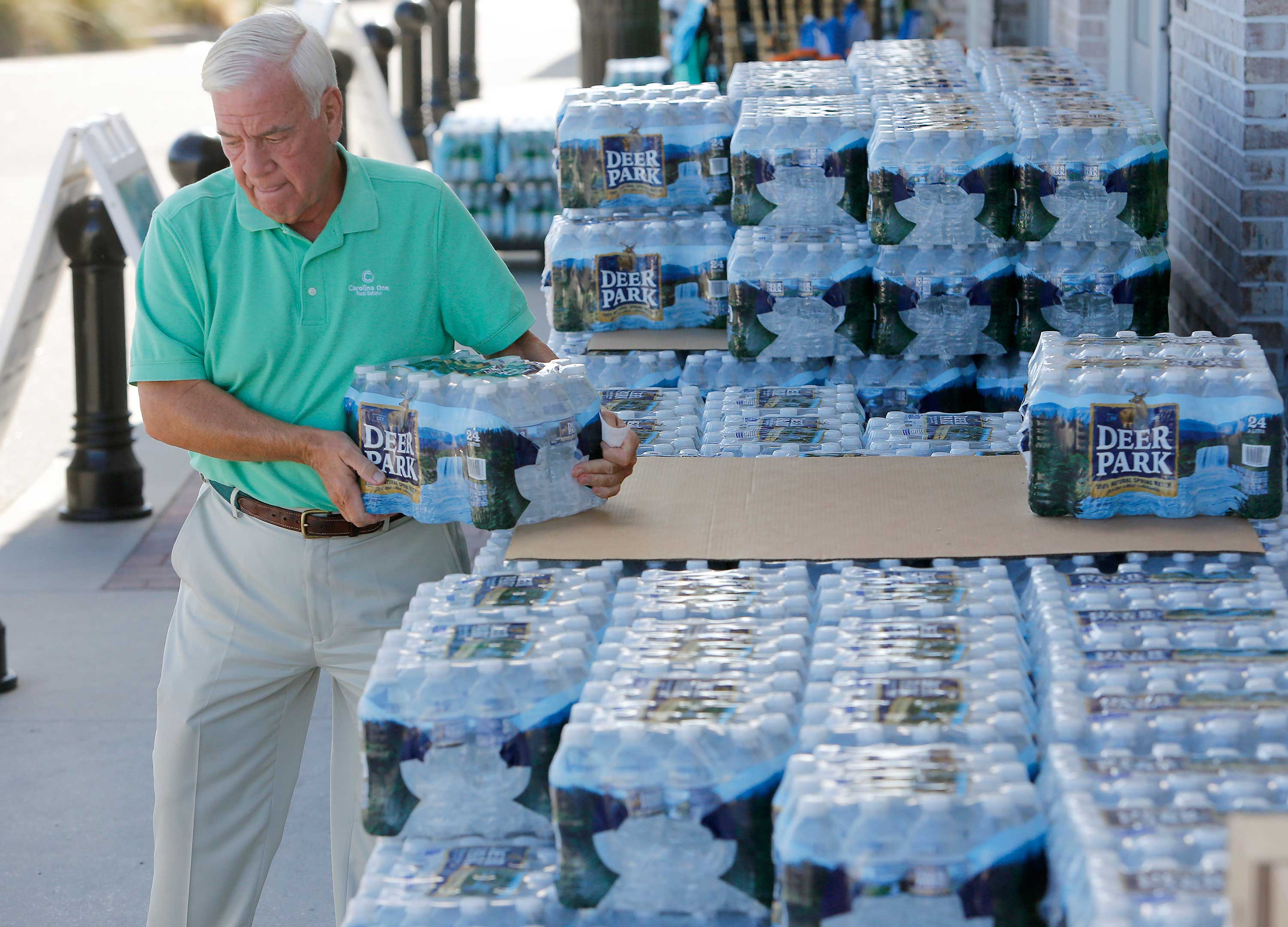 <div class='meta'><div class='origin-logo' data-origin='none'></div><span class='caption-text' data-credit='Mic Smith/AP Photo'>Larry Pierson, from the Isle of Palms, S.C., purchases bottled water from the Harris Teeter grocery store on the Isle of Palms in preparation for Hurricane Florence on Monday.</span></div>