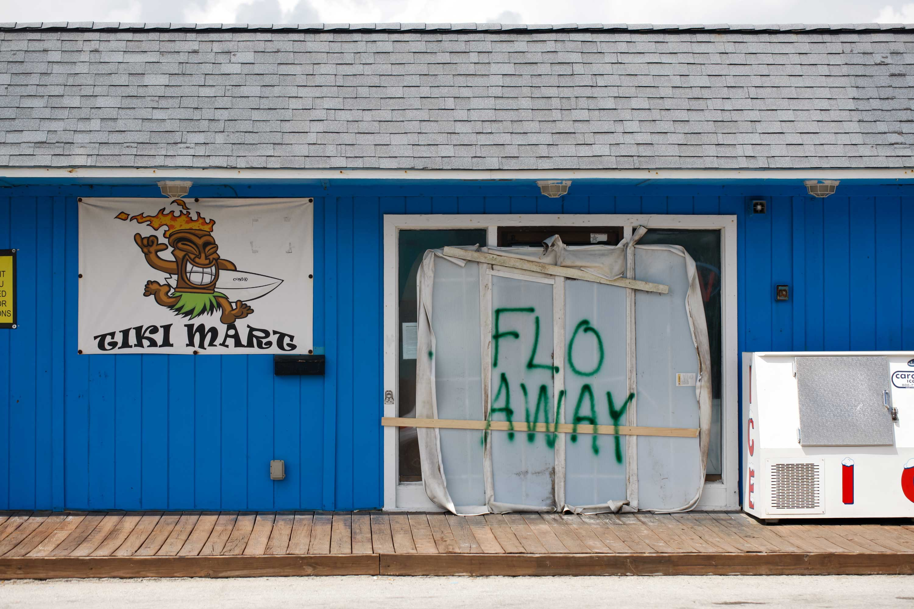 "<div class=""meta image-caption""><div class=""origin-logo origin-image none""><span>none</span></div><span class=""caption-text"">A Tiki bar sits empty with the message ""FLO AWAY"" September 11, 2018 on Topsail Island, North Carolina, where homes and businesses have boarded up. (LOGAN CYRUS/AFP/Getty Images)</span></div>"