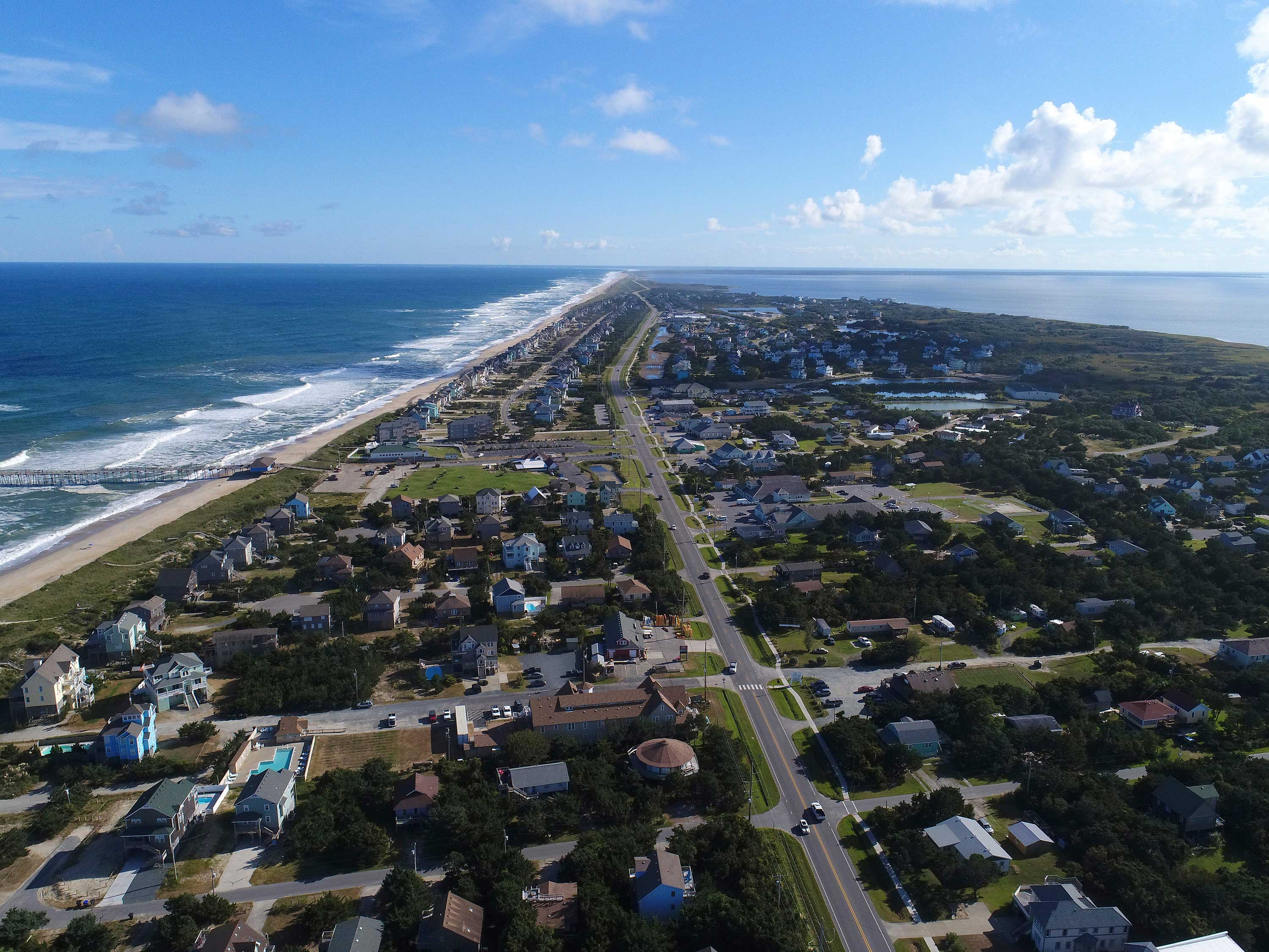 <div class='meta'><div class='origin-logo' data-origin='none'></div><span class='caption-text' data-credit=''>In this Monday afternoon, Sept. 10, 2018 photo provided by DroneBase, an aerial view of Avon, N.C., in the Outer Banks is shown ahead of Hurricane Florence.</span></div>
