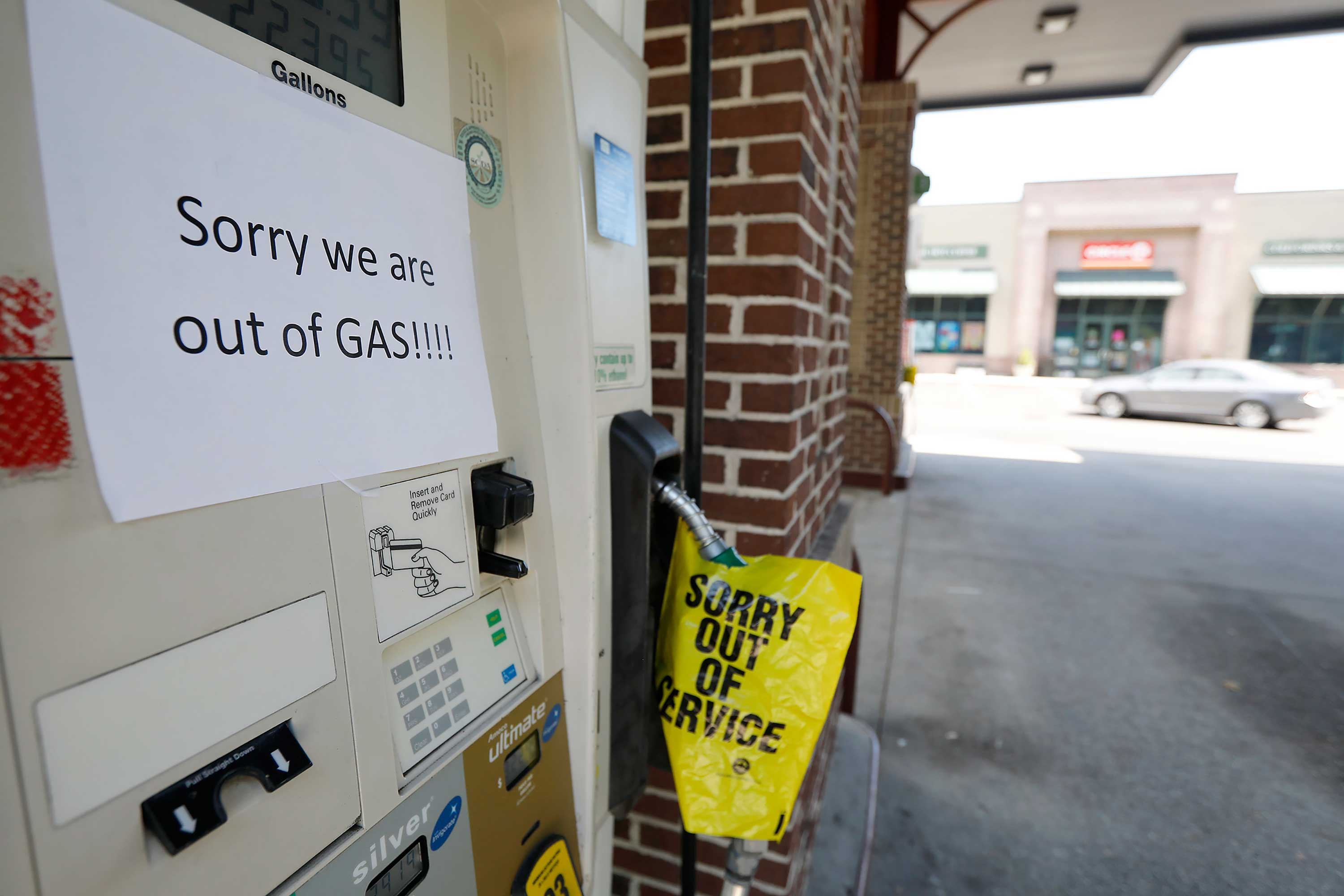 <div class='meta'><div class='origin-logo' data-origin='none'></div><span class='caption-text' data-credit='Mic Smith/AP Photo'>A gas station in Mt. Pleasant S.C. alerts motorist that it is out of gas due to the heavy demand caused by Hurricane Florence Tuesday, Sept. 11, 2018.</span></div>