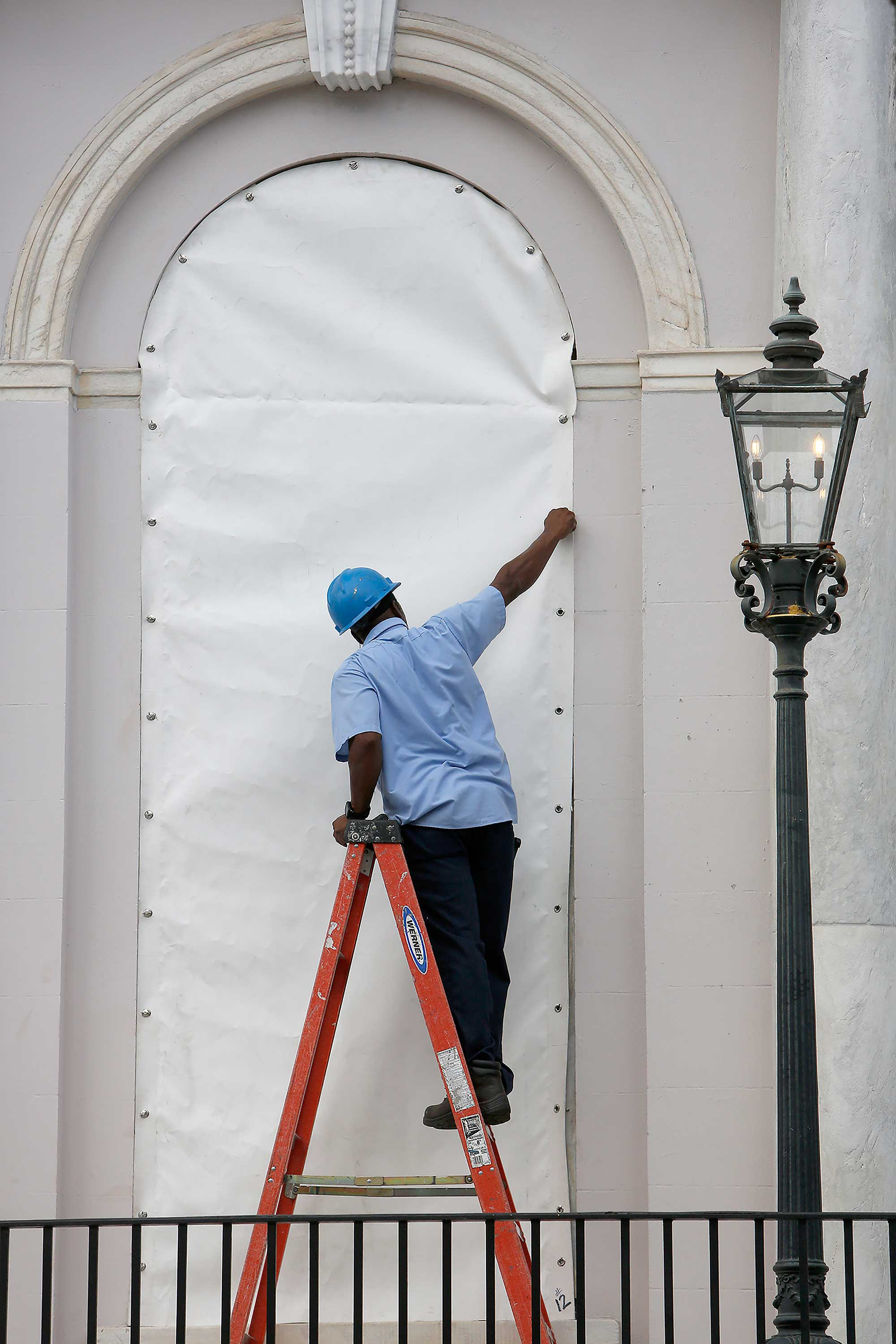 <div class='meta'><div class='origin-logo' data-origin='none'></div><span class='caption-text' data-credit='Mic Smith/AP Photo'>A worker covers a window at Charleston City Hall in Charleston, S.C.</span></div>
