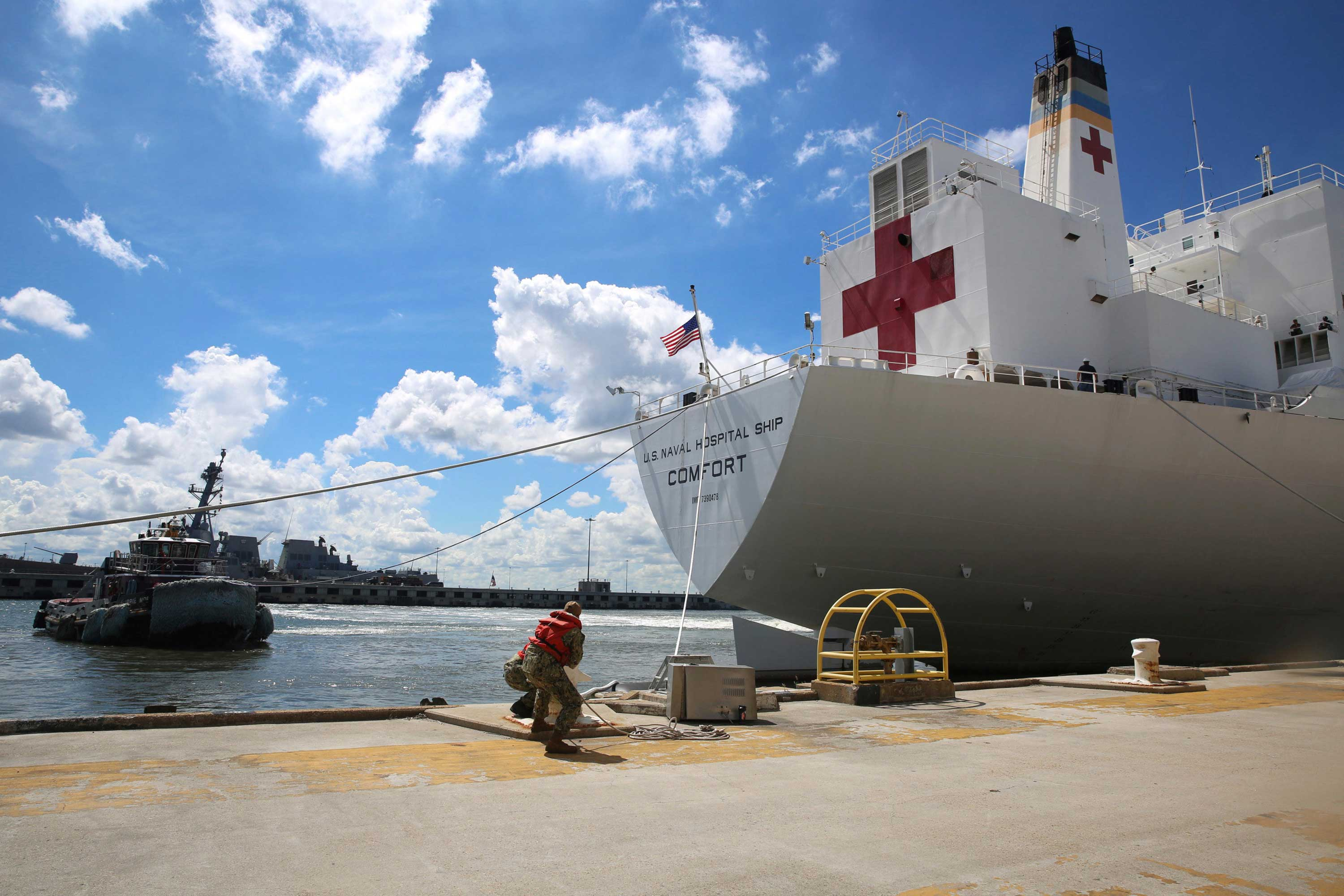 <div class='meta'><div class='origin-logo' data-origin='none'></div><span class='caption-text' data-credit='Jennifer Hunt/U.S. Navy via AP'>Sailors cast off mooring lines to the Military Sealift Command hospital ship USNS Comfort (T-AH 20) Tuesday, Sept. 11, 2018.</span></div>