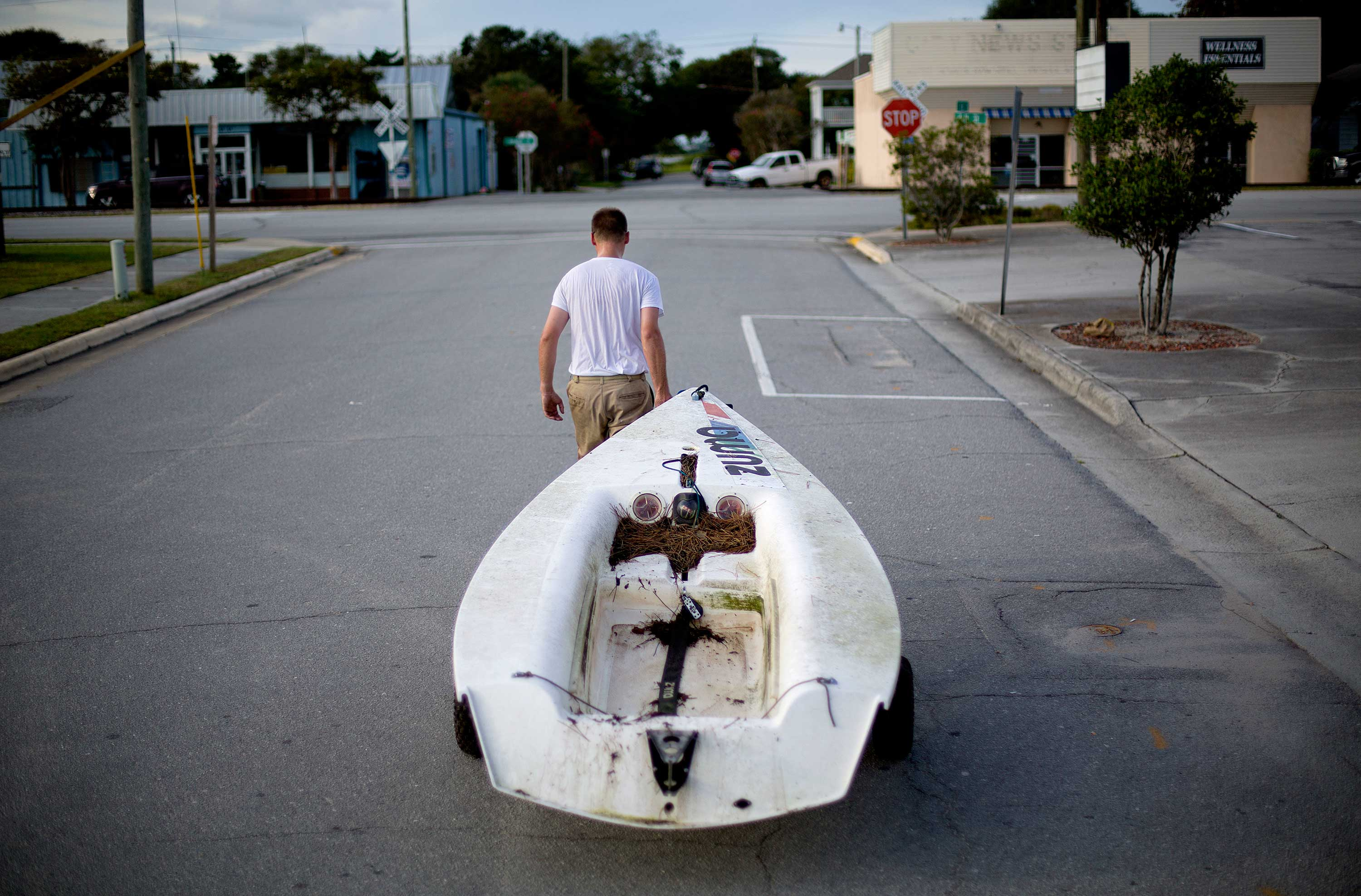 <div class='meta'><div class='origin-logo' data-origin='none'></div><span class='caption-text' data-credit='David Goldman/AP Photo'>Emmett West pulls his boat from a nearby marina to secure it at his home ahead Hurricane Florence in Morehead City, N.C., Tuesday, Sept. 11.</span></div>