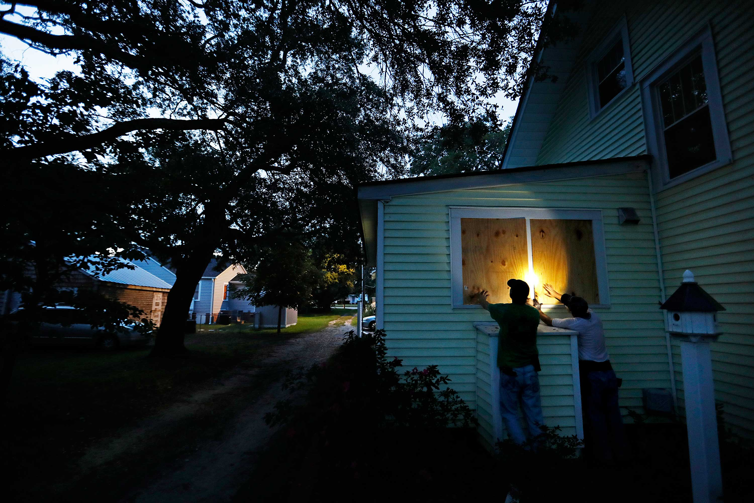 <div class='meta'><div class='origin-logo' data-origin='none'></div><span class='caption-text' data-credit='David Goldman/AP Photo'>Russell Meadows, left, helps neighbor Rob Muller board up his home ahead of Hurricane Florence in Morehead City, N.C., Tuesday, Sept. 11, 2018.</span></div>