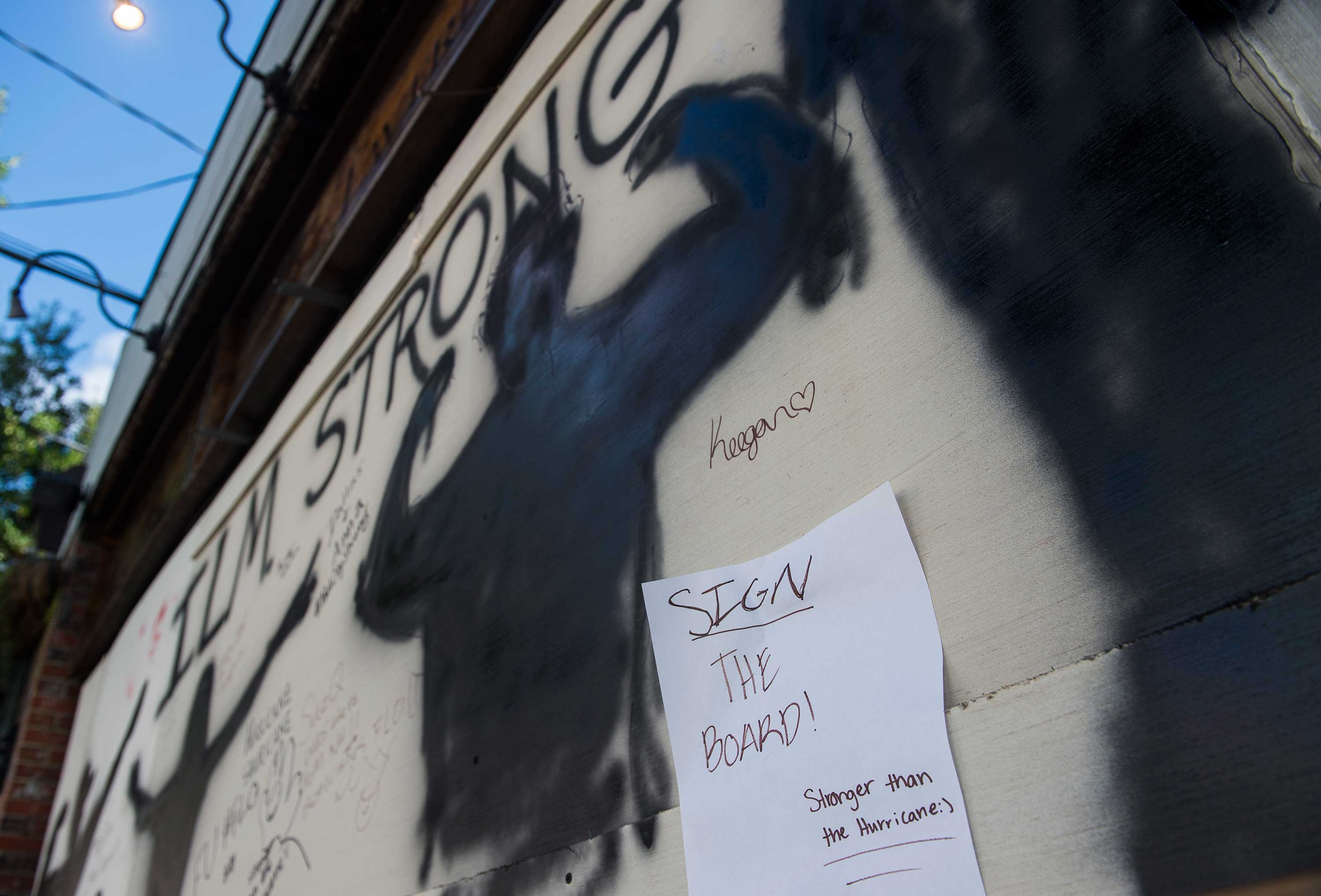 <div class='meta'><div class='origin-logo' data-origin='none'></div><span class='caption-text' data-credit='ANDREW CABALLERO-REYNOLDS/AFP/Getty Images'>A sign is seen on a boarded up bar in Wilmington, North Carolina on September 12, 2018.</span></div>