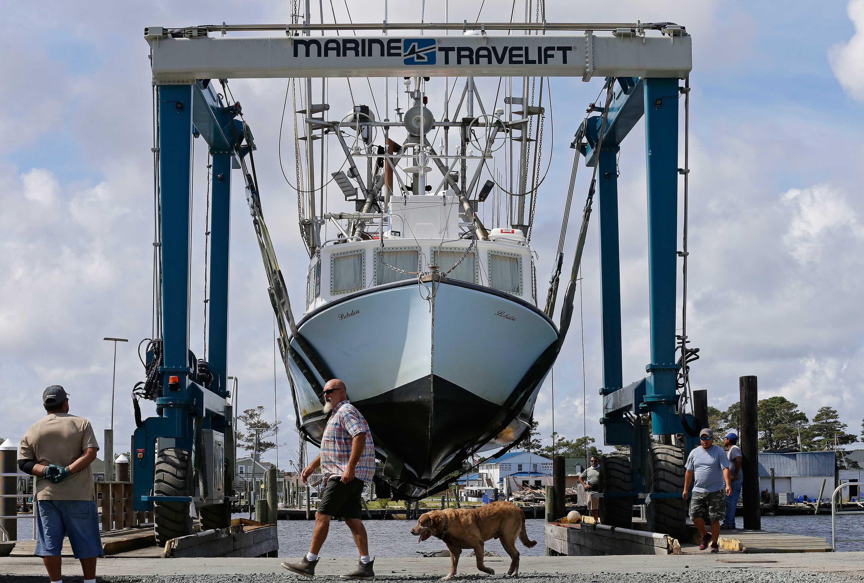 <div class='meta'><div class='origin-logo' data-origin='none'></div><span class='caption-text' data-credit='Gerry Broome/AP Photo'>Workers take boats out of the water in Wanchese Harbor as Hurricane Florence approaches the coast of the Carolinas on Wednesday, Sept. 12, 2018, in Wanchese, N.C.</span></div>