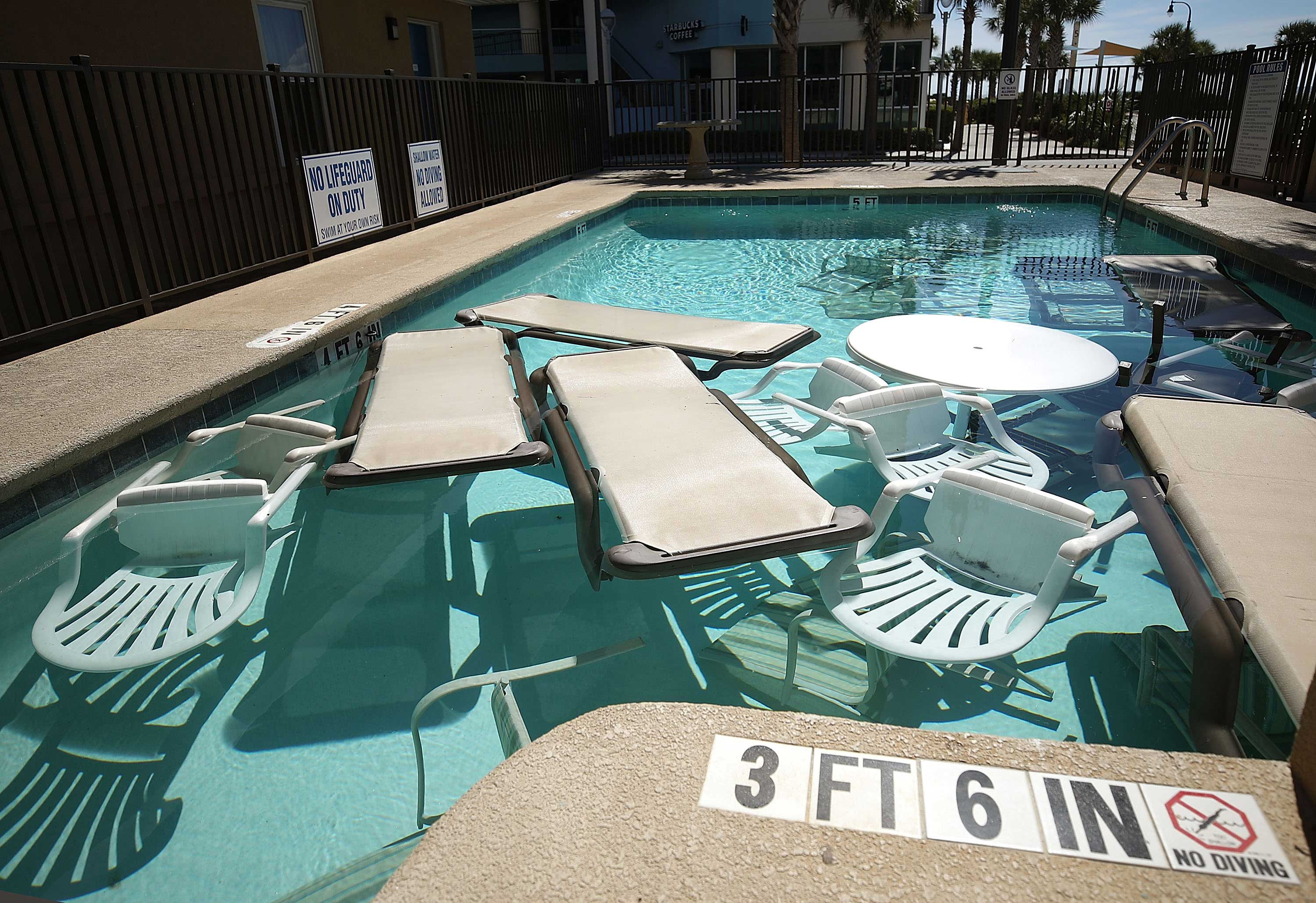 "<div class=""meta image-caption""><div class=""origin-logo origin-image none""><span>none</span></div><span class=""caption-text"">Poolside furniture is placed in the pool of a hotel ahead of the approaching Hurricane Florence on September 12, 2018. (Mark Wilson/Getty Images)</span></div>"