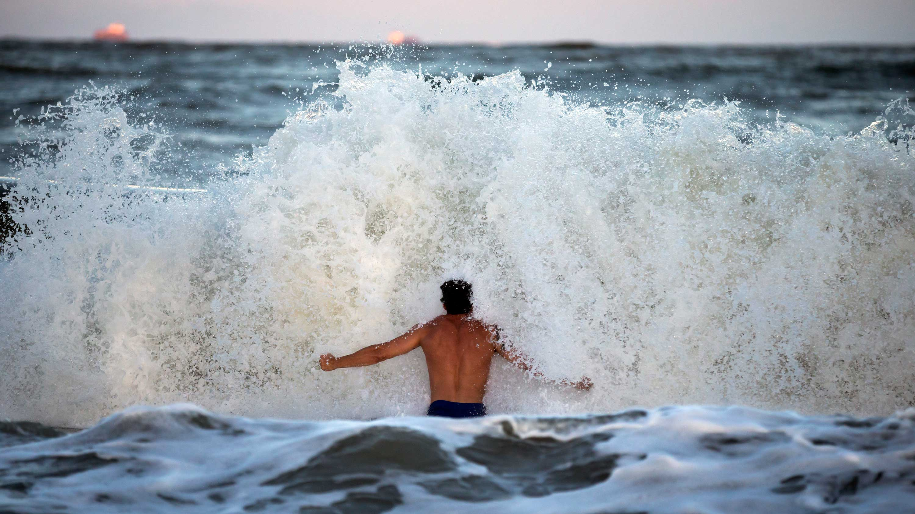 <div class='meta'><div class='origin-logo' data-origin='none'></div><span class='caption-text' data-credit='Stephen B. Morton/AP Photo'>Body surfer Andrew Vanotteren, of Savannah, Ga., crashes into waves from Hurricane Florence, Wednesday, Sept., 12, 2018, on the south beach of Tybee Island, Ga.</span></div>