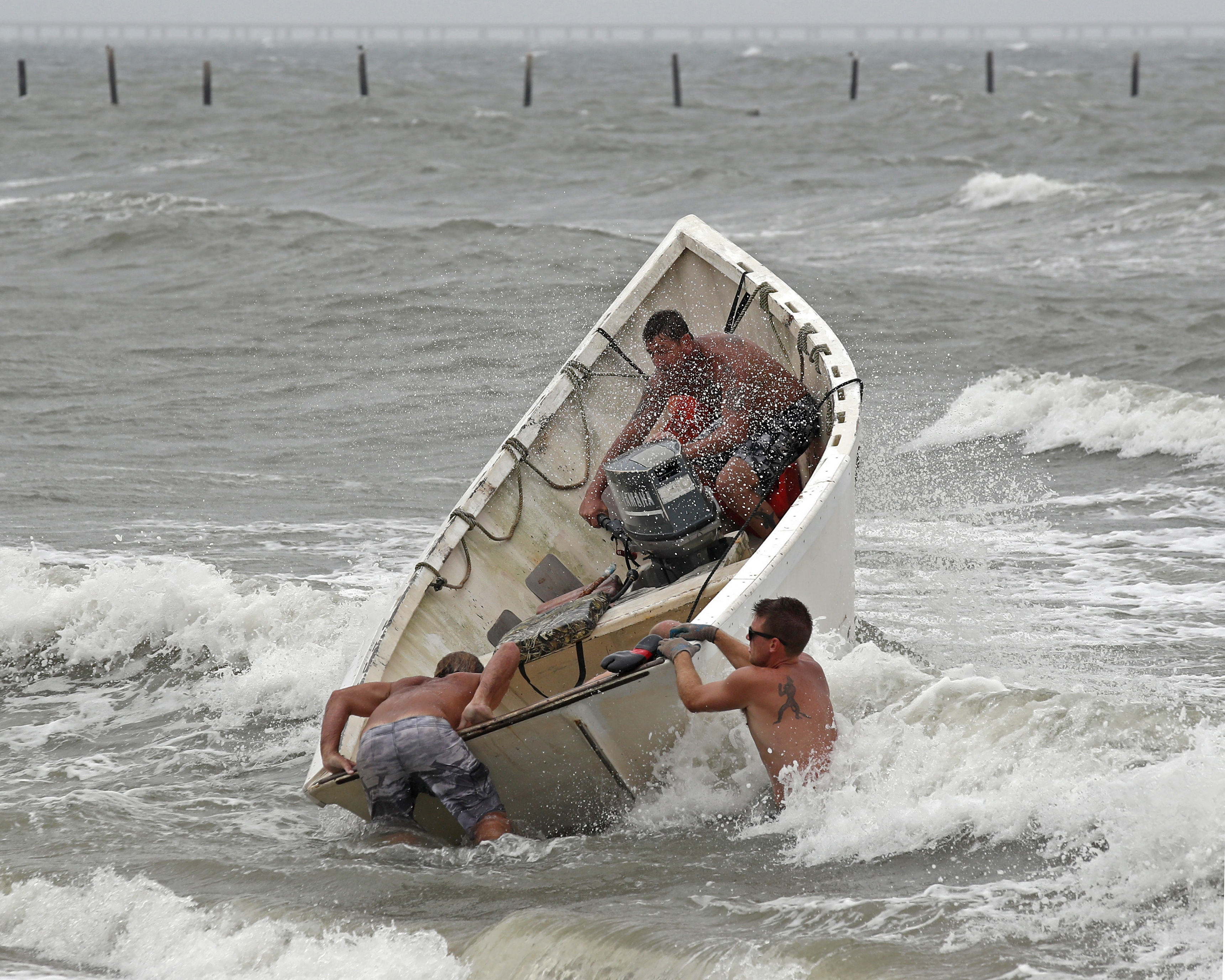 "<div class=""meta image-caption""><div class=""origin-logo origin-image ap""><span>AP</span></div><span class=""caption-text"">Fishermen launch a boat as they attempt to recover their haul-seine fishing net in Virginia Beach, Va., as Hurricane Florence moves towards the eastern shore. (AP Photo/Alex Brandon)</span></div>"