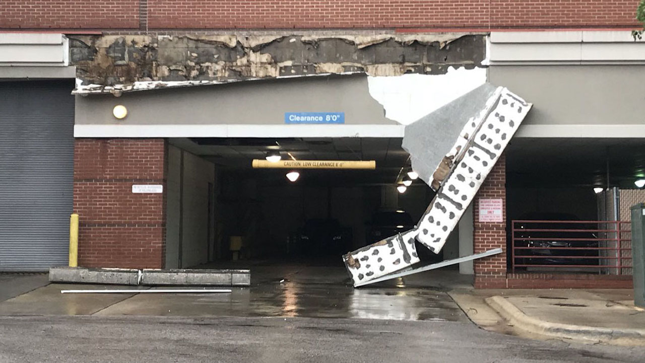 <div class='meta'><div class='origin-logo' data-origin='WTVD'></div><span class='caption-text' data-credit='Thomas Ross/Twitter'>A parking deck in the Cameron Village development in Raleigh, North Carolina, that was damaged during Hurricane Florence</span></div>