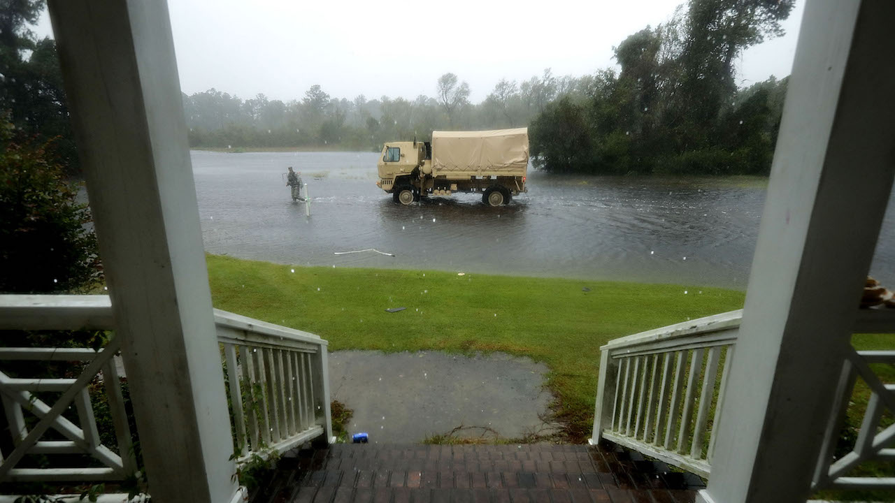 "<div class=""meta image-caption""><div class=""origin-logo origin-image wabc""><span>wabc</span></div><span class=""caption-text"">Members of the North Carolina National Guard search homes for evacuees during Hurricane Florence September 14, 2018, in Fairfield Harbour, North Carolina. (Chip Somodevilla/Getty Images)</span></div>"