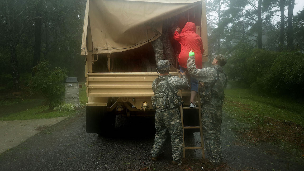 "<div class=""meta image-caption""><div class=""origin-logo origin-image wabc""><span>wabc</span></div><span class=""caption-text"">Members of the North Carolina National Guard help an evacuee into a truck during Hurricane Florence September 14, 2018, in Fairfield Harbour, North Carolina. (Chip Somodevilla/Getty Images)</span></div>"