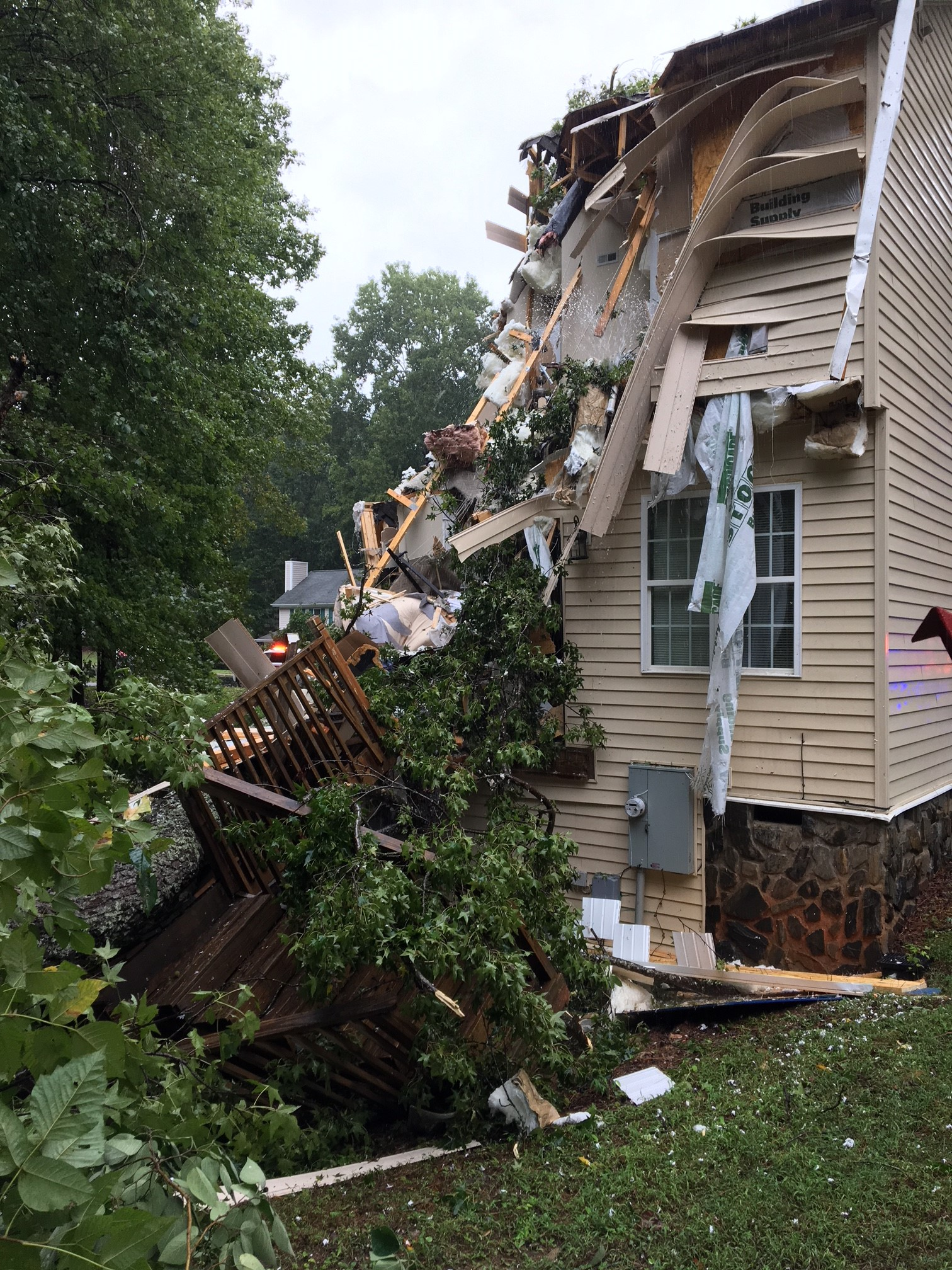 "<div class=""meta image-caption""><div class=""origin-logo origin-image wtvd""><span>WTVD</span></div><span class=""caption-text"">A home in Wake Forest is severely damaged by a fallen tree as Florence's outer bands lash the Triangle on Friday. (Town of Wake Forest)</span></div>"