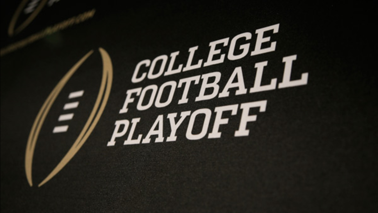 The College Football Playoff logo is printed across a backdrop used during a news conference on Wednesday, Oct. 16, 2013.