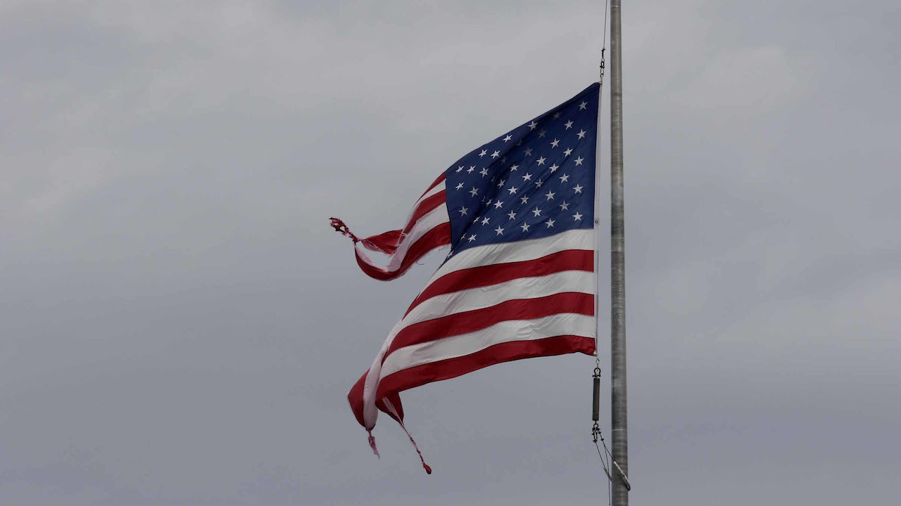 <div class='meta'><div class='origin-logo' data-origin='AP'></div><span class='caption-text' data-credit='AP Photo/Tom Copeland'>A tattered American flag after Hurricane Florence in Jacksonville N.C., Sunday, Sept. 16, 2018.</span></div>