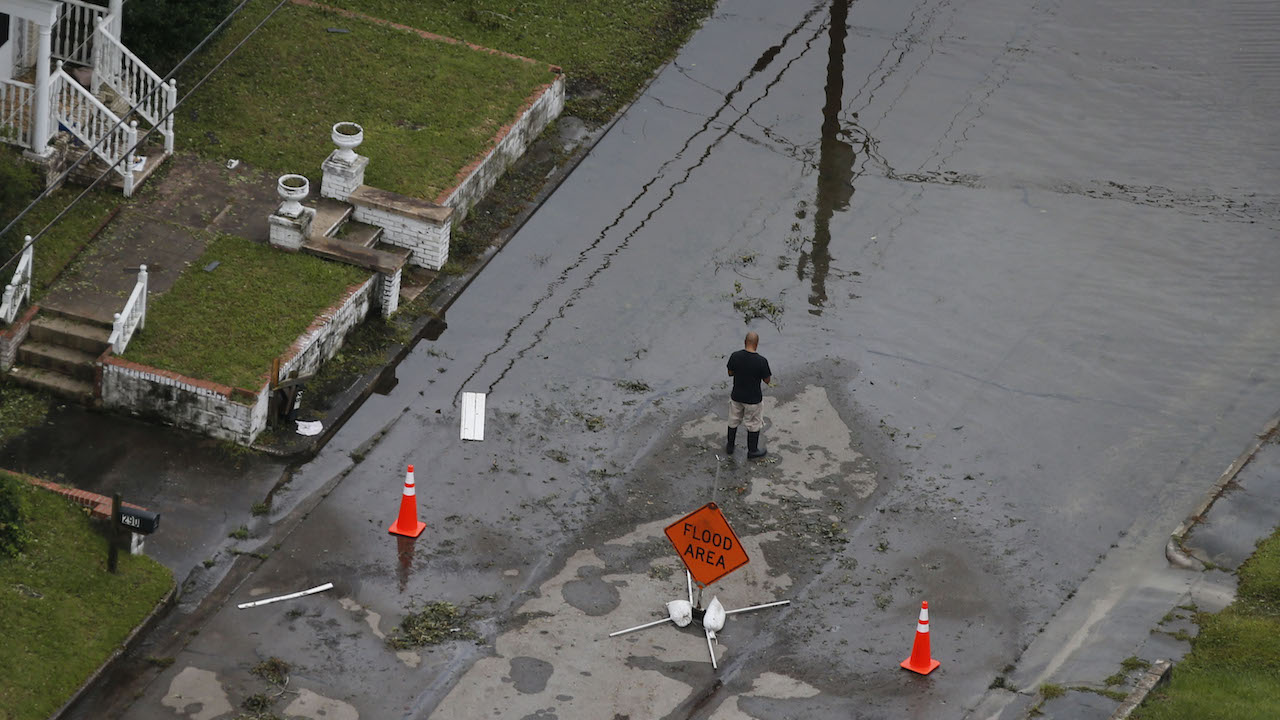 <div class='meta'><div class='origin-logo' data-origin='AP'></div><span class='caption-text' data-credit='AP Photo/Steve Helber'>A resident looks over a flooded street due to high tides and rain from hurricane Florence which moved through the area in Jacksonville, N.C., Sunday, Sept. 16, 2018.</span></div>
