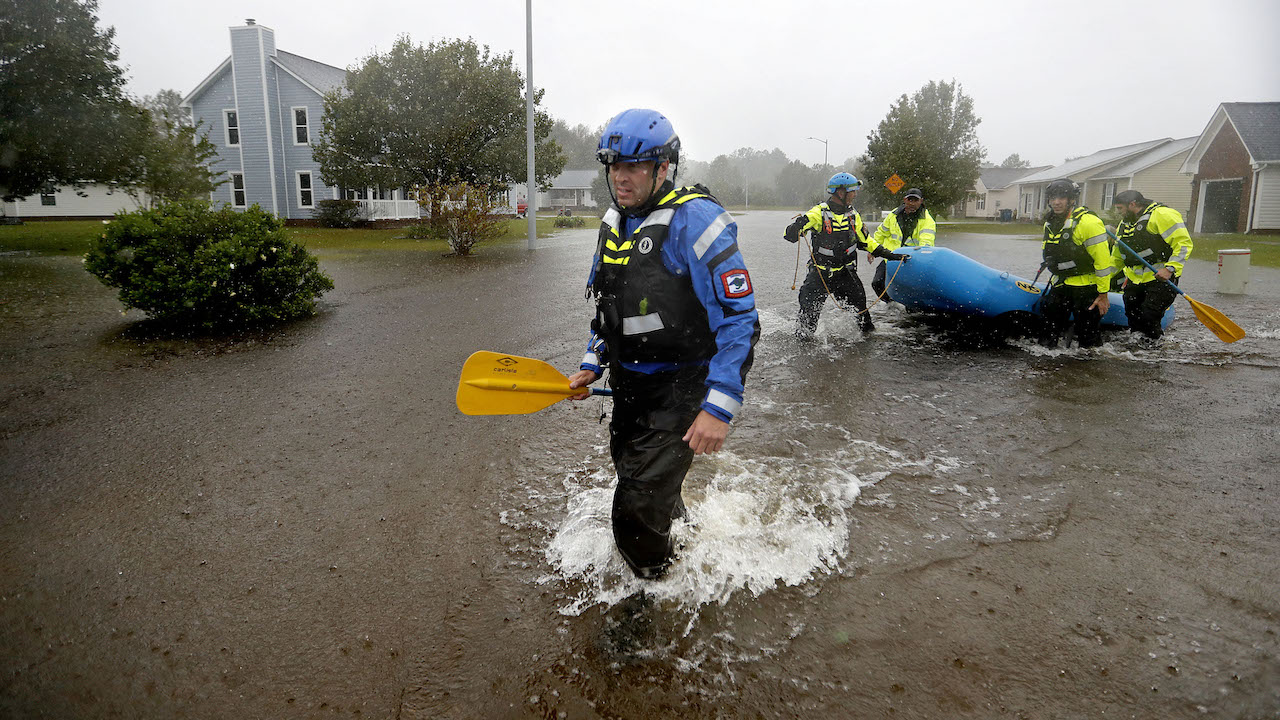 <div class='meta'><div class='origin-logo' data-origin='AP'></div><span class='caption-text' data-credit='AP Photo/David Goldman'>The North Carolina Task Force urban search and rescue team carries a boat into a flooded neighborhood looking for residents who stayed behind in Fayetteville, N.C., Sept. 16, 2018.</span></div>