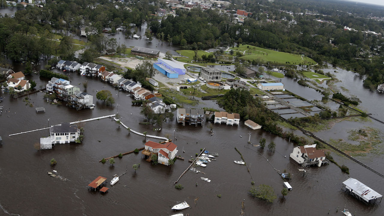 <div class='meta'><div class='origin-logo' data-origin='AP'></div><span class='caption-text' data-credit='AP Photo/Steve Helber'>Homes and a marina are flooded as a result of high tides and rain from hurricane Florence which moved through the area in Jacksonville, N.C., Sunday, Sept. 16, 2018.</span></div>
