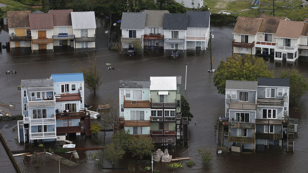 <div class='meta'><div class='origin-logo' data-origin='AP'></div><span class='caption-text' data-credit='APAP Photo/Steve Helber'>Homes along the New River are flooded as a result of high tides and rain from hurricane Florence which moved through the area in Jacksonville, N.C., Sunday, Sept. 16, 2018.</span></div>
