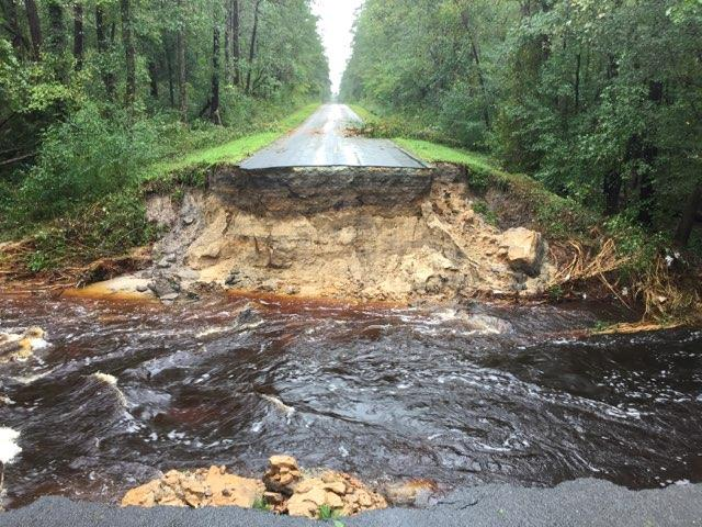 "<div class=""meta image-caption""><div class=""origin-logo origin-image wtvd""><span>WTVD</span></div><span class=""caption-text"">A road in Ivanhoe, N.C., in Sampson County is washed out. (ABC11 Eyewitness)</span></div>"