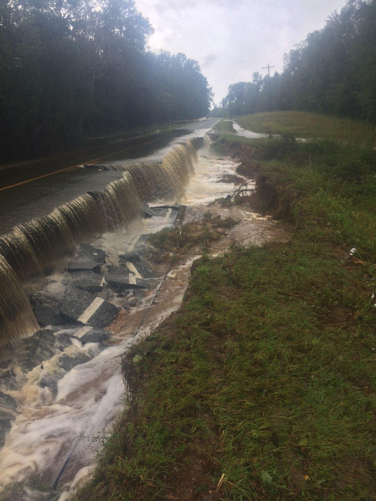 <div class='meta'><div class='origin-logo' data-origin='WTVD'></div><span class='caption-text' data-credit='ABC11 Eyewitness'>A road in Ivanhoe, N.C., in Sampson County is washed out.</span></div>