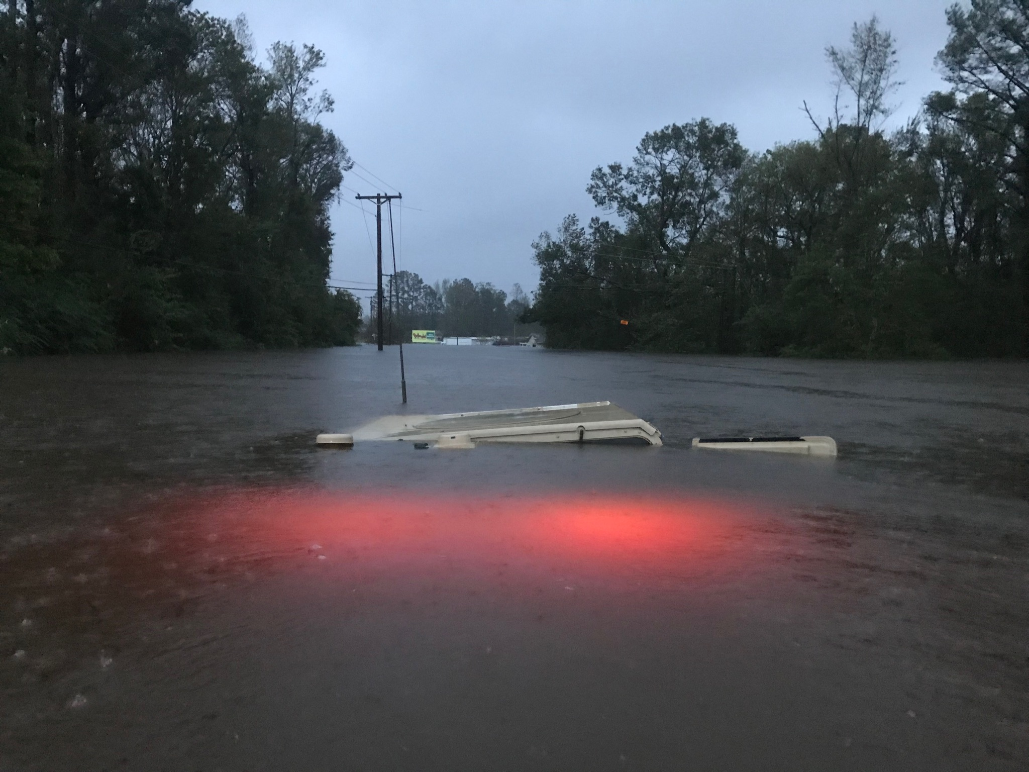 <div class='meta'><div class='origin-logo' data-origin='WTVD'></div><span class='caption-text' data-credit='ABC11 Eyewitness - Kaycie Burns'>The lights remain on in this flooded military HMMWV in Jacksonville, NC.</span></div>