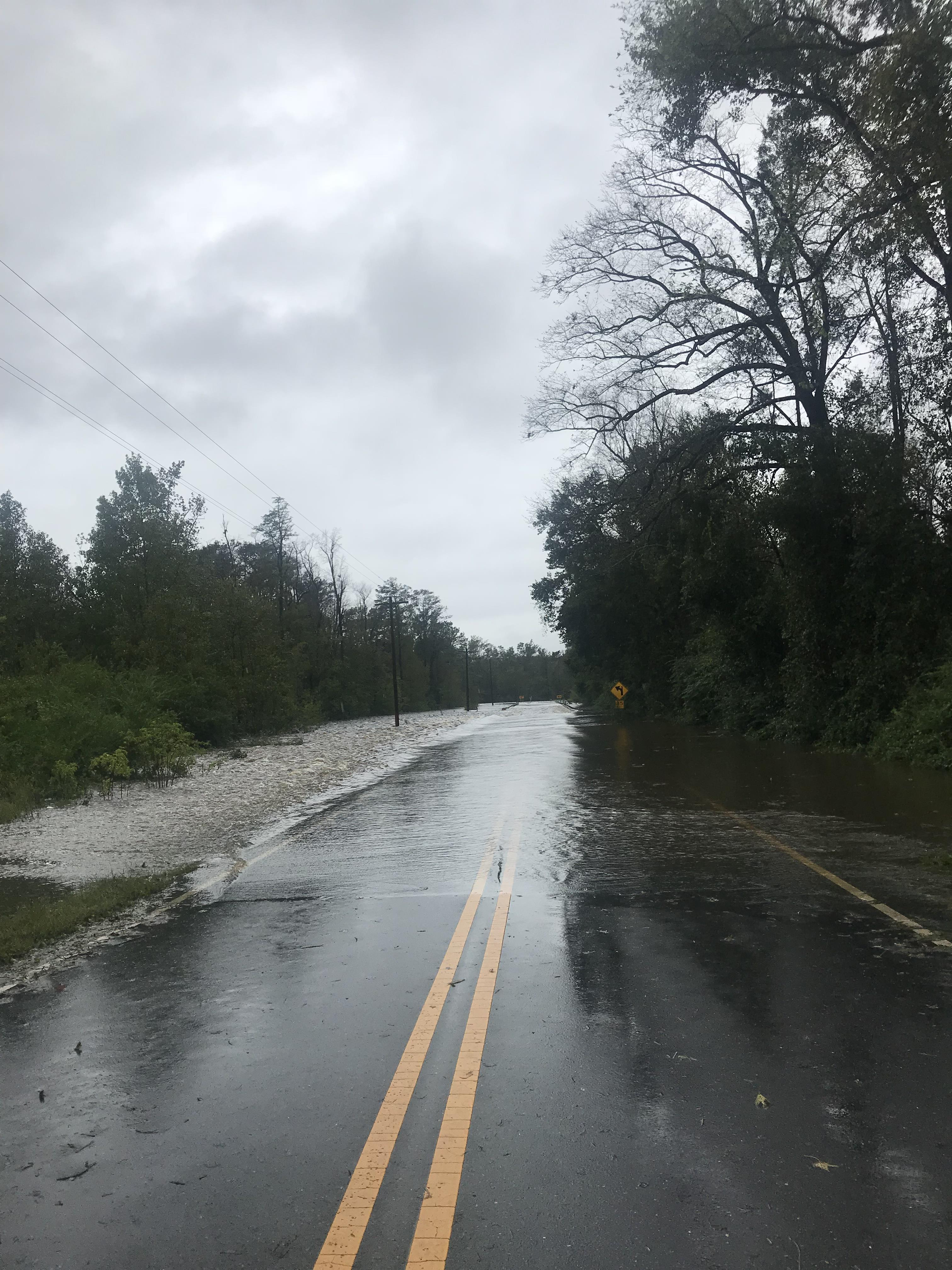 "<div class=""meta image-caption""><div class=""origin-logo origin-image wtvd""><span>WTVD</span></div><span class=""caption-text"">Minnie Hall Road Bridge is flooded near Salemburg, N.C. in Sampson County. (ABC11 Eyewitness - Candis Tyndall)</span></div>"