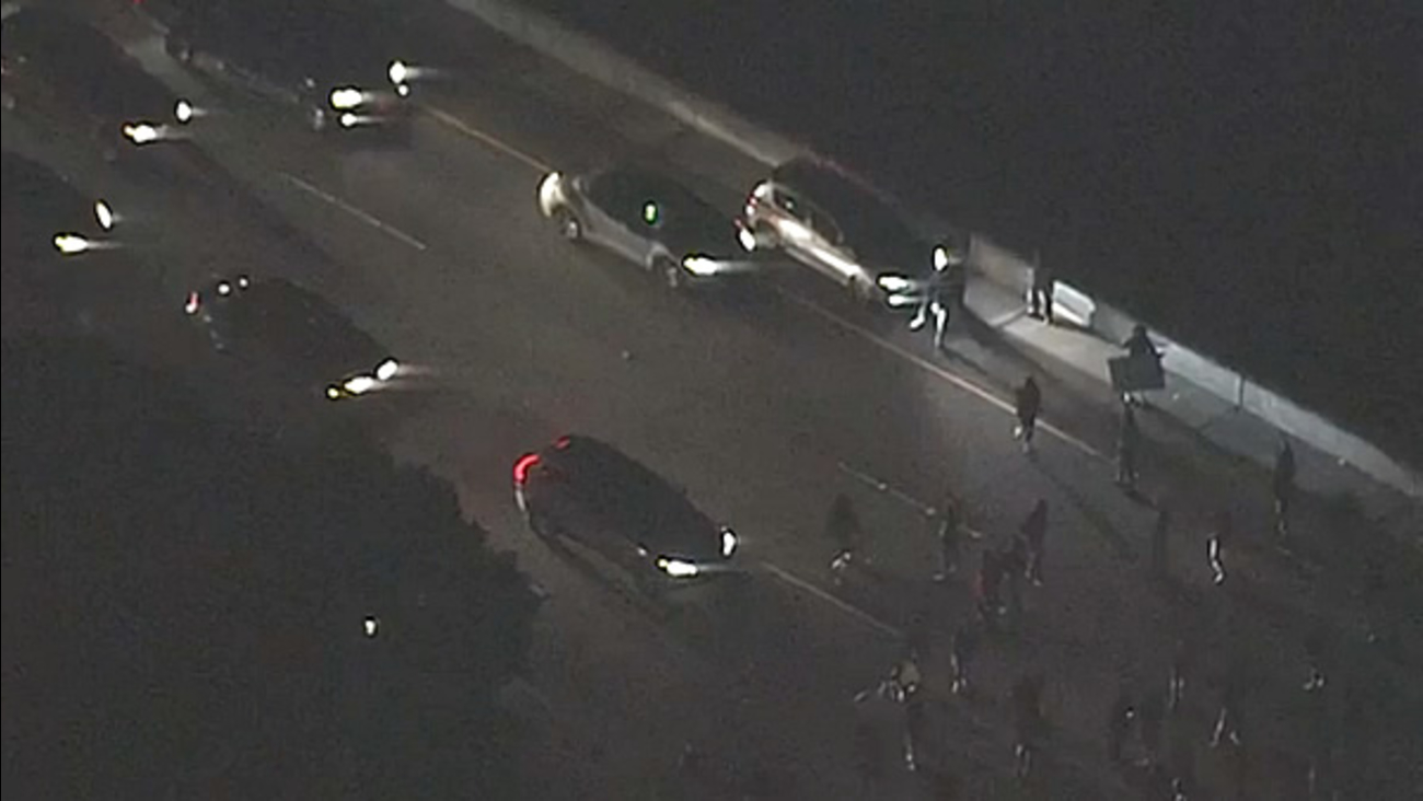 Demonstrators block all EB lanes of Highway 24 at 52nd Street in Oakland