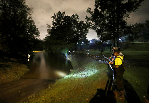 <div class='meta'><div class='origin-logo' data-origin='AP'></div><span class='caption-text' data-credit='AP Photo/David Goldman'>A group of local fishermen keep an eye on the Cape Fear River as they stage for potential water rescues after Florence, in Fayetteville, N.C., Sunday, Sept. 16, 2018.</span></div>