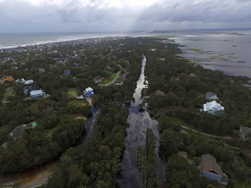 <div class='meta'><div class='origin-logo' data-origin='AP'></div><span class='caption-text' data-credit='AP Photo/Tom Copeland'>Coast Guard Road leading to the south end of Emerald Isle is seen after Hurricane Florence hit Emerald Isle, N.C., Sunday, Sept. 16, 2018.</span></div>