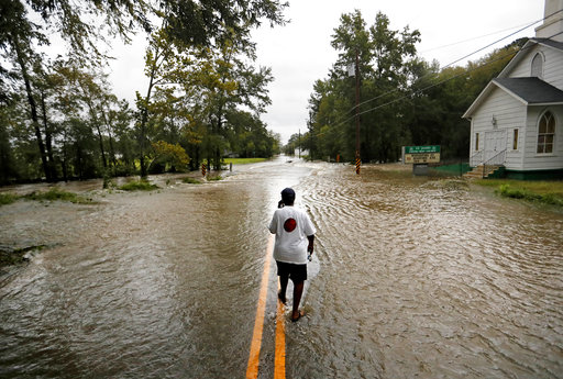 <div class='meta'><div class='origin-logo' data-origin='AP'></div><span class='caption-text' data-credit='AP Photo/David Goldman'>Helen McKoy walks down a flooded street in her neighborhood as Florence continues to dump heavy rain in Fayetteville, N.C., Sunday, Sept. 16, 2018.</span></div>
