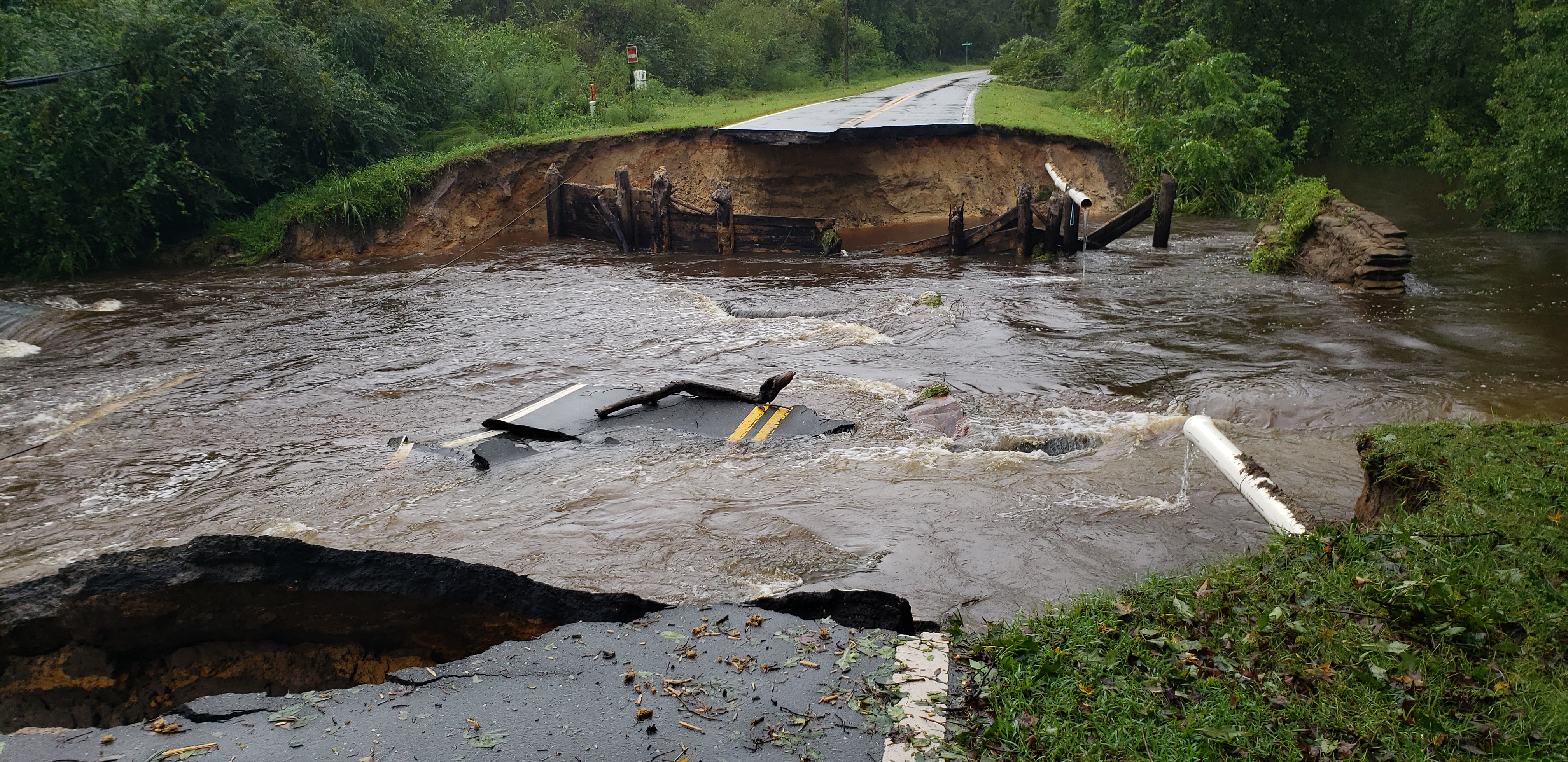 <div class='meta'><div class='origin-logo' data-origin='WTVD'></div><span class='caption-text' data-credit='ABC11 Eyewitness - Jeremy Henderson'>This road was washed out near Bear Marsh Church.</span></div>