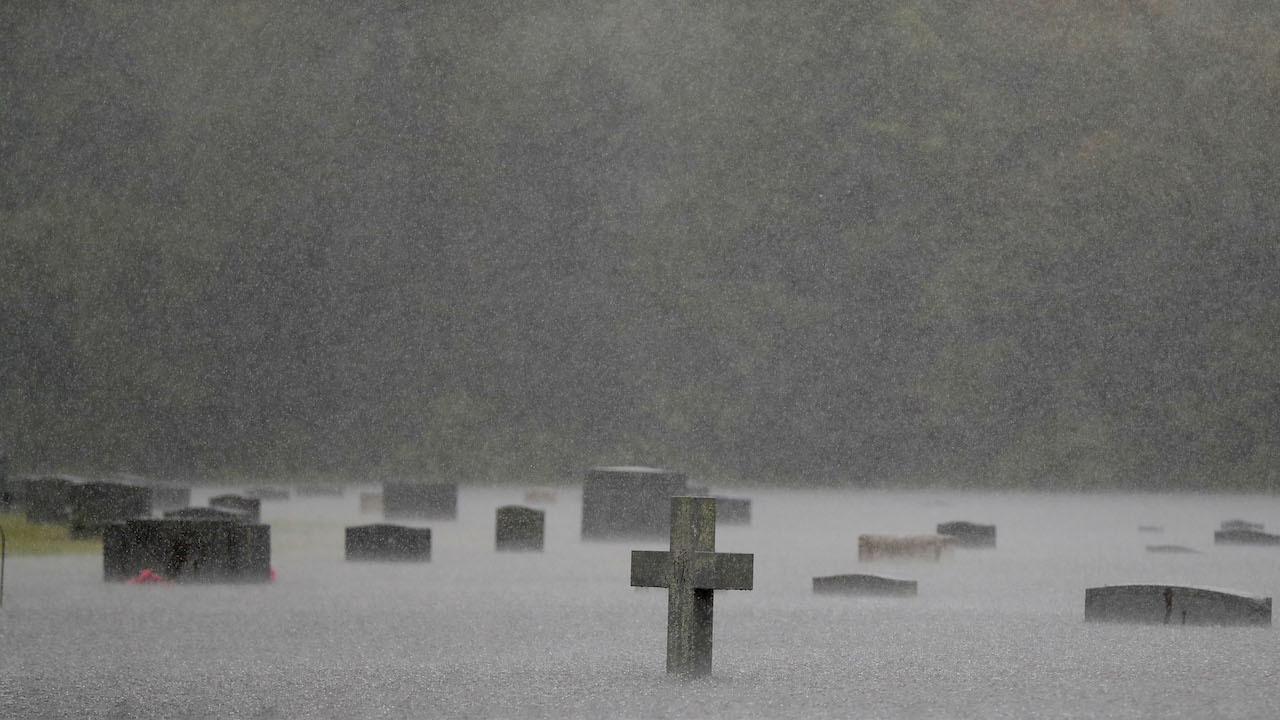"<div class=""meta image-caption""><div class=""origin-logo origin-image ap""><span>AP</span></div><span class=""caption-text"">A flooded cemetery is seen during heavy rains from Florence in Marion, S.C., Sunday, Sept. 16, 2018. Downgraded overnight to a tropical depression, Florence was still massive. (AP Photo/Gerald Herbert)</span></div>"