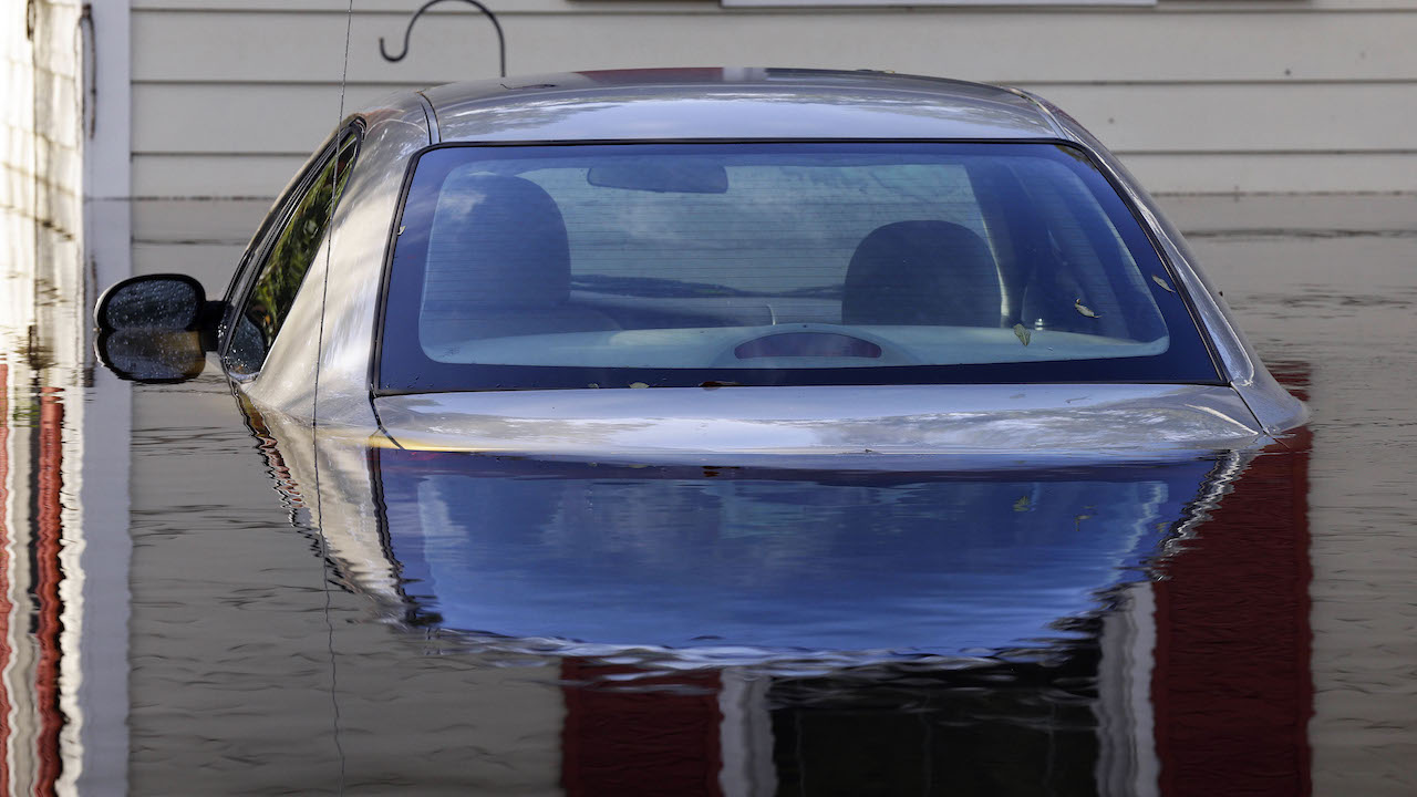 <div class='meta'><div class='origin-logo' data-origin='AP'></div><span class='caption-text' data-credit='AP Photo/Gerry Broome'>A submerged car sits surrounded by water outside a home in a flooded neighborhood in Lumberton, N.C., Monday, Sept. 17, 2018, in the aftermath of Hurricane Florence.</span></div>