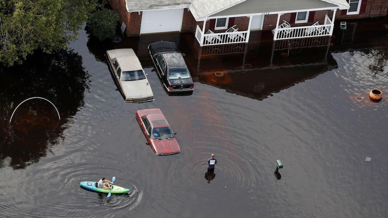 <div class='meta'><div class='origin-logo' data-origin='AP'></div><span class='caption-text' data-credit='AP Photo/Gerald Herbert'>A man paddles a kayak in a flooded neighborhood in the aftermath of Hurricane Florence, in Fayetteville, N.C., Monday, Sept. 17, 2018.</span></div>