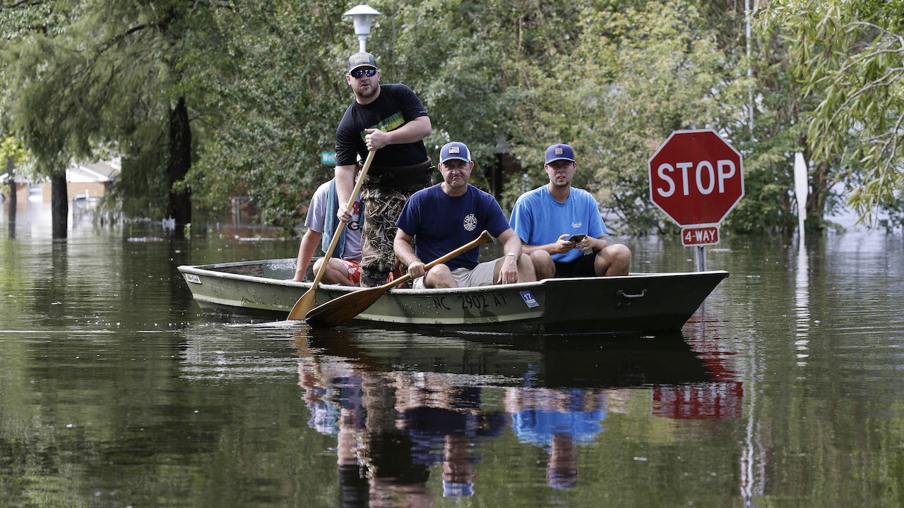 <div class='meta'><div class='origin-logo' data-origin='AP'></div><span class='caption-text' data-credit='AP Photo/Gerry Broome'>Residents paddle a boat through a flooded neighborhood in Lumberton, N.C., Monday, Sept. 17, 2018, in the aftermath of Hurricane Florence.</span></div>