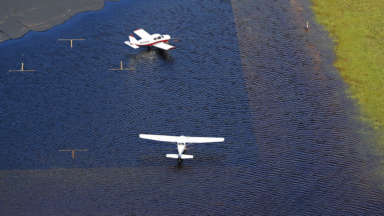 <div class='meta'><div class='origin-logo' data-origin='AP'></div><span class='caption-text' data-credit='AP Photo/Gerald Herbert'>Airplanes sit in floodwaters at Curtis Brown Field in the aftermath of Hurricane Florence in Elizabethtown, N.C., Monday, Sept. 17, 2018.</span></div>