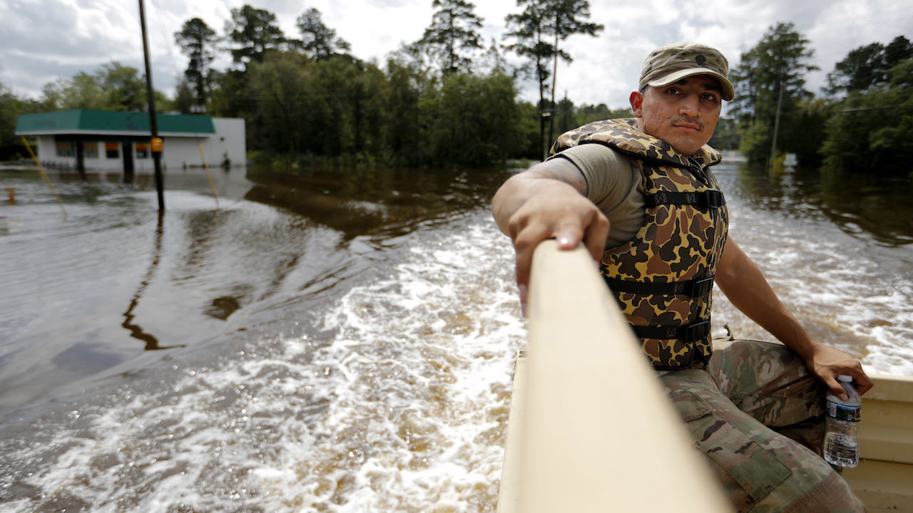 <div class='meta'><div class='origin-logo' data-origin='AP'></div><span class='caption-text' data-credit='AP Photo/David Goldman'>U.S. Army Spc. Daniel Ochoa rides in the back of a high water vehicle while searching for residents to evacuate from a flooded neighborhood.</span></div>