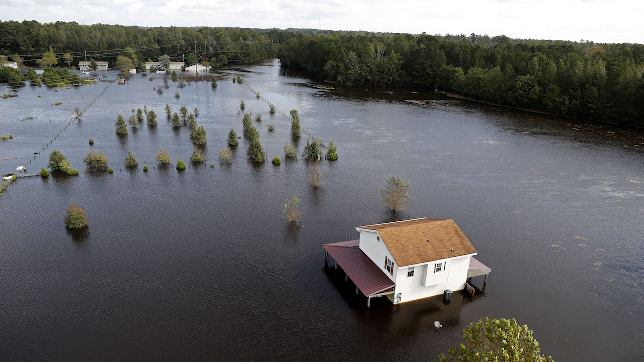 "<div class=""meta image-caption""><div class=""origin-logo origin-image ap""><span>AP</span></div><span class=""caption-text"">A house is surrounded by floodwaters from Hurricane Florence in Lumberton, N.C., Monday, Sept. 17, 2018. (AP Photo/Gerald Herbert)</span></div>"