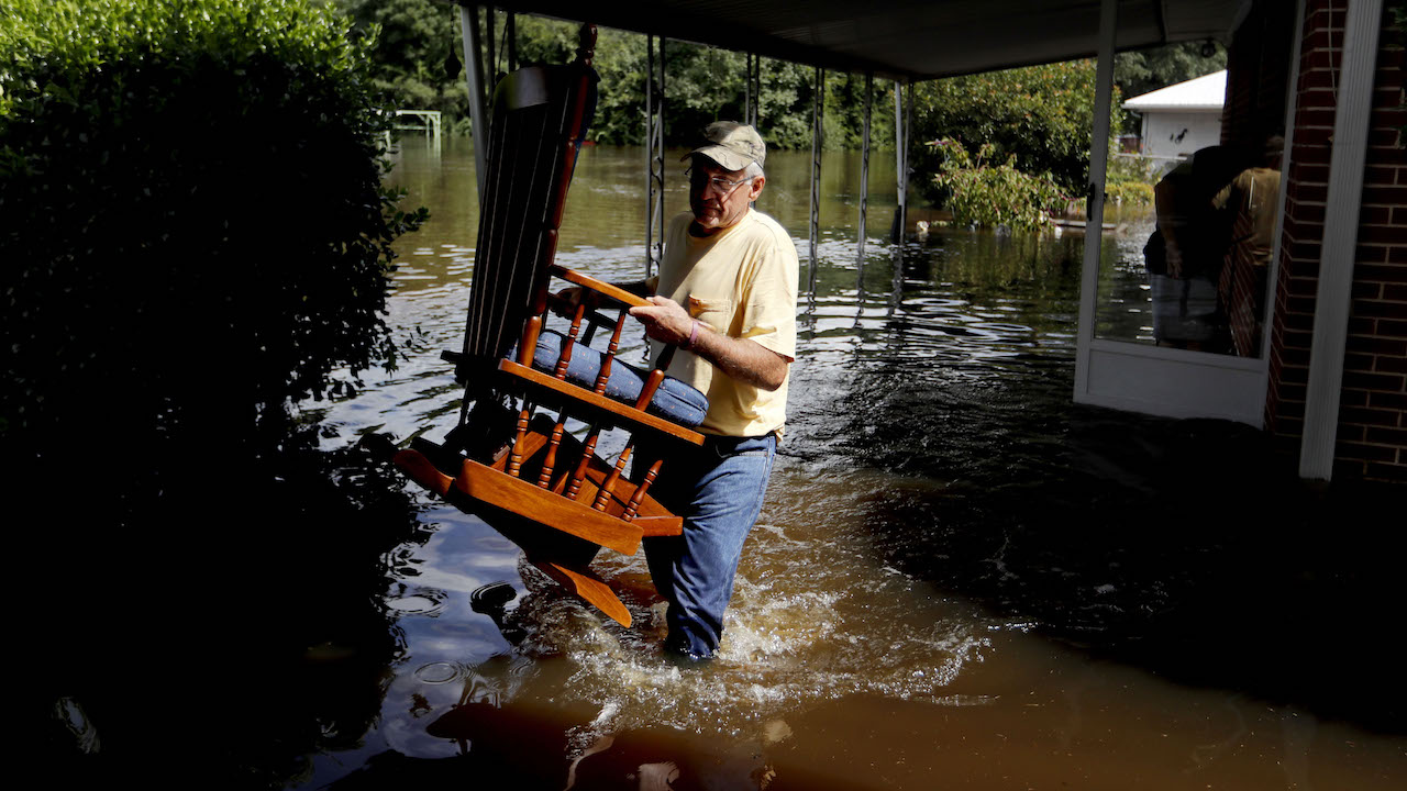 "<div class=""meta image-caption""><div class=""origin-logo origin-image ap""><span>AP</span></div><span class=""caption-text"">Bob Richling carries out a rocking chair for 84-year-old Iris Darden as she evacuates her flooded home in the aftermath of Hurricane Florence. (AP Photo/David Goldman)</span></div>"