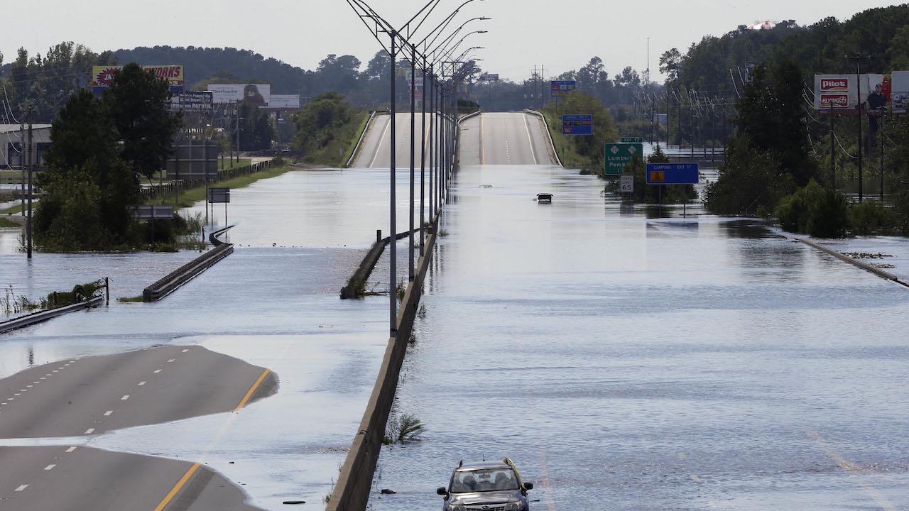 <div class='meta'><div class='origin-logo' data-origin='AP'></div><span class='caption-text' data-credit='AP Photo/Gerry Broome'>Flooded vehicles sit on a closed section of Interstate 95 in Lumberton, N.C., Monday, Sept. 17, 2018, where the Lumber river overflowed following flooding from Hurricane Florence</span></div>