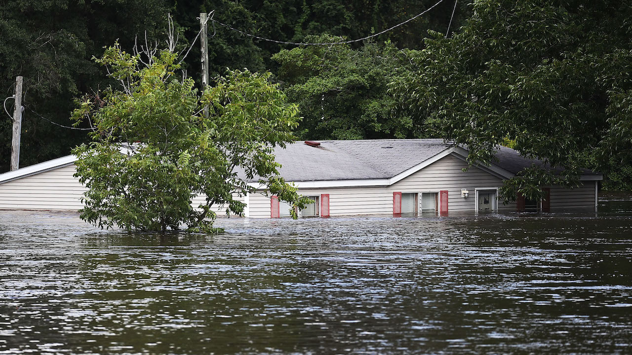 <div class='meta'><div class='origin-logo' data-origin='Creative Content'></div><span class='caption-text' data-credit='Joe Raedle/Getty Images'>Flood waters are seen around a home as the Little River overflows its banks on September 17, 2018, in Spring Lake, North Carolina.</span></div>