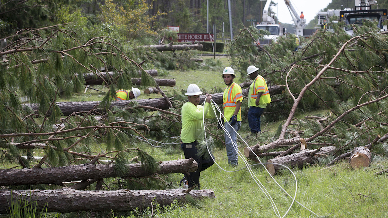 "<div class=""meta image-caption""><div class=""origin-logo origin-image wabc""><span>wabc</span></div><span class=""caption-text"">Employees of Xylem Tree Experts work to clear downed pine trees and free up utility lines downed by Hurricane Florence along NC 306 near the Cherry Branch Ferry Terminal. (Robert Willett/Raleigh News & Observer/TNS via Getty Images)</span></div>"